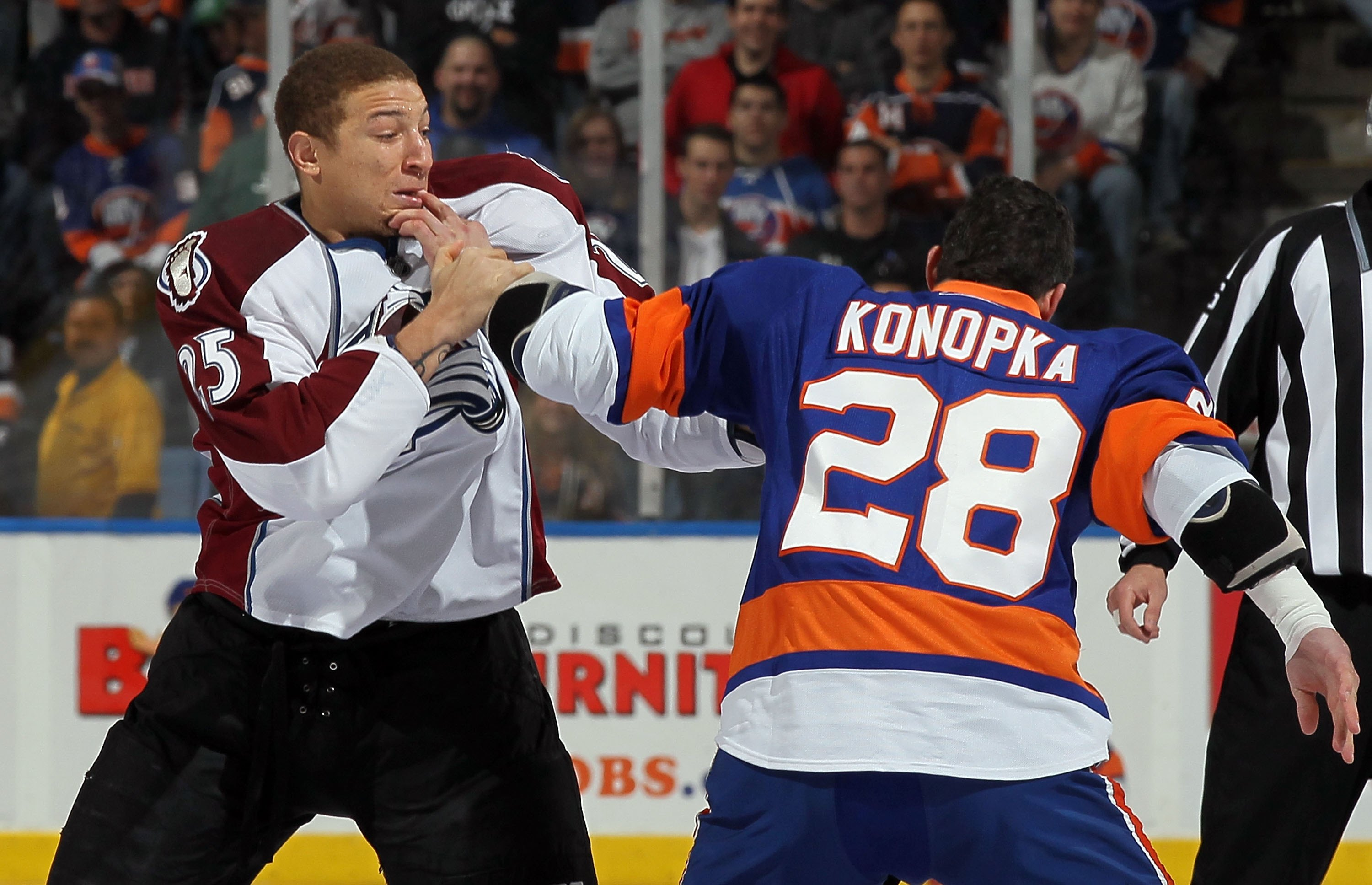 UNIONDALE, NY - OCTOBER 16:  Chris Stewart #25 of the Colorado Avalanche trades punches with Zenon Konopka #28 of the New York Islanders five seconds into their game on October 16, 2010 at Nassau Coliseum in Uniondale, New York.  (Photo by Jim McIsaac/Get