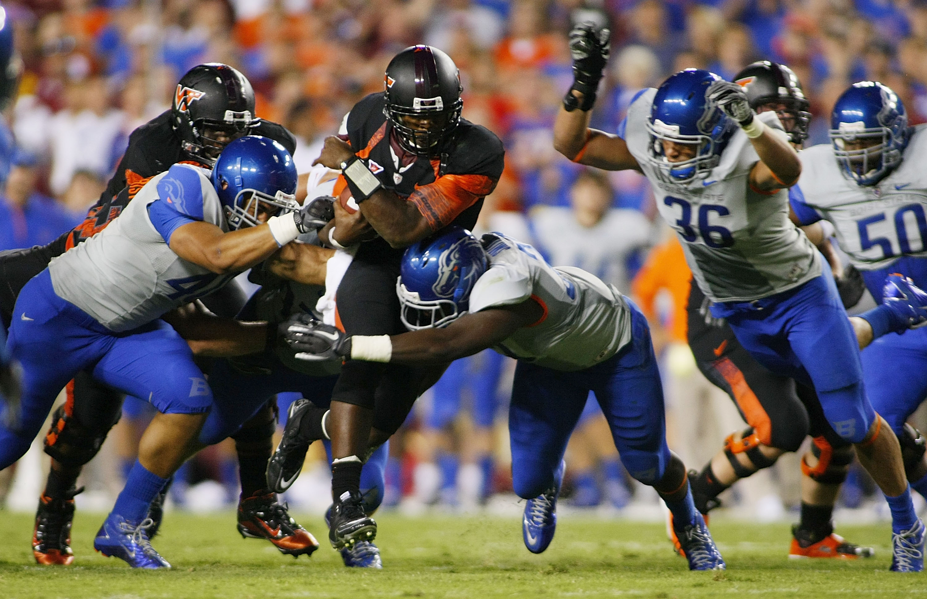 LANDOVER, MD - SEPTEMBER 06:  Quarterback #5 Tyrod Taylor of the Virginia Tech Hokies is tackled by defensive end #40 Tyrone Crawford, linebacker #33 Tommy Smith, and linebacker Aaron Tevis of the Boise State Broncos at FedExField on September 6, 2010 in