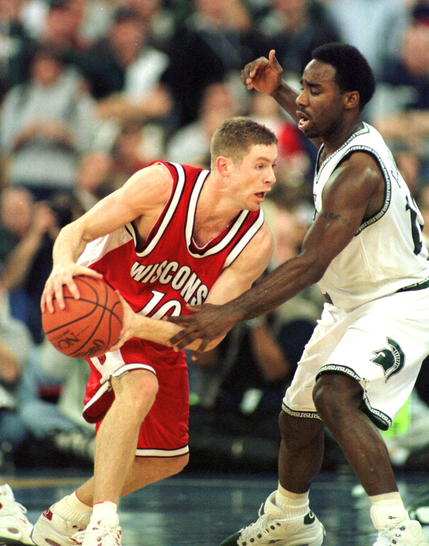 1 Apr 2000:  Jon Bryant #10 of Wisconsin tries to dribble around Mateen Cleaves #12 of Michigan State during the semifinal round of the NCAA Final Four at the RCA Dome in Indianapolis, Indiana.  Mandatory Credit: Jed Jacobsohn/ALLSPORT
