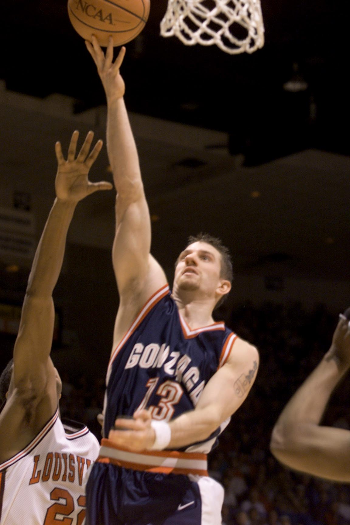 16 Mar 2000:  Matt Santangelo of Gonzaga shoots over Reece Gaines of Louisville during the first round of the Western Regional NCAA Tournament at the McKale Center in Tucson, Arizona. X DIGITAL IMAGE Mandatory Credit: Jed Jacobsohn/ALLSPORT