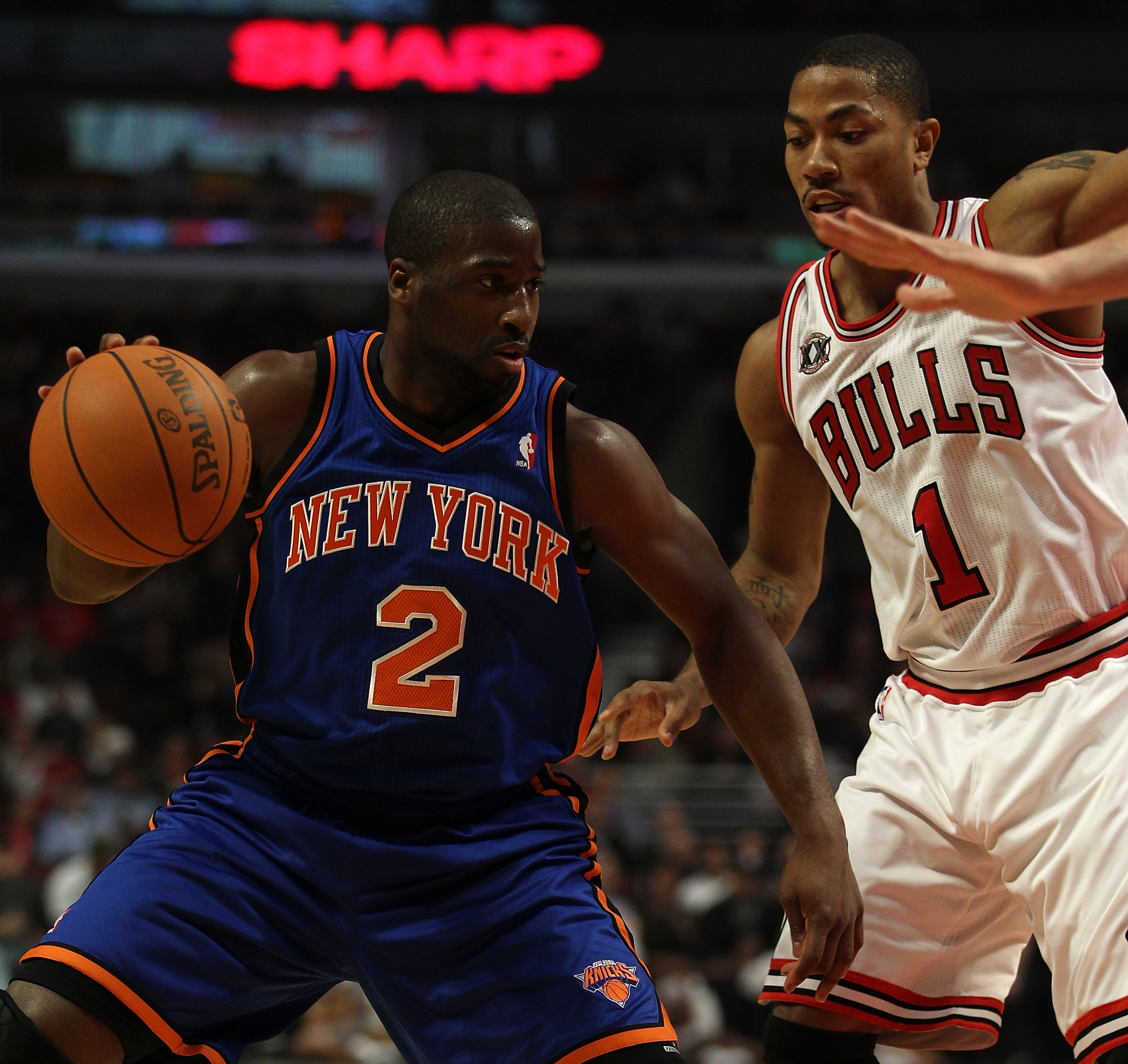 CHICAGO - NOVEMBER 04: Raymond Felton #2 of the New York Knicks moves against Derrick Rose #1 of the Chicago Bulls at the United Center on November 4, 2010 in Chicago, Illinois. NOTE TO USER: User expressly acknowledges and agrees that, by downloading and
