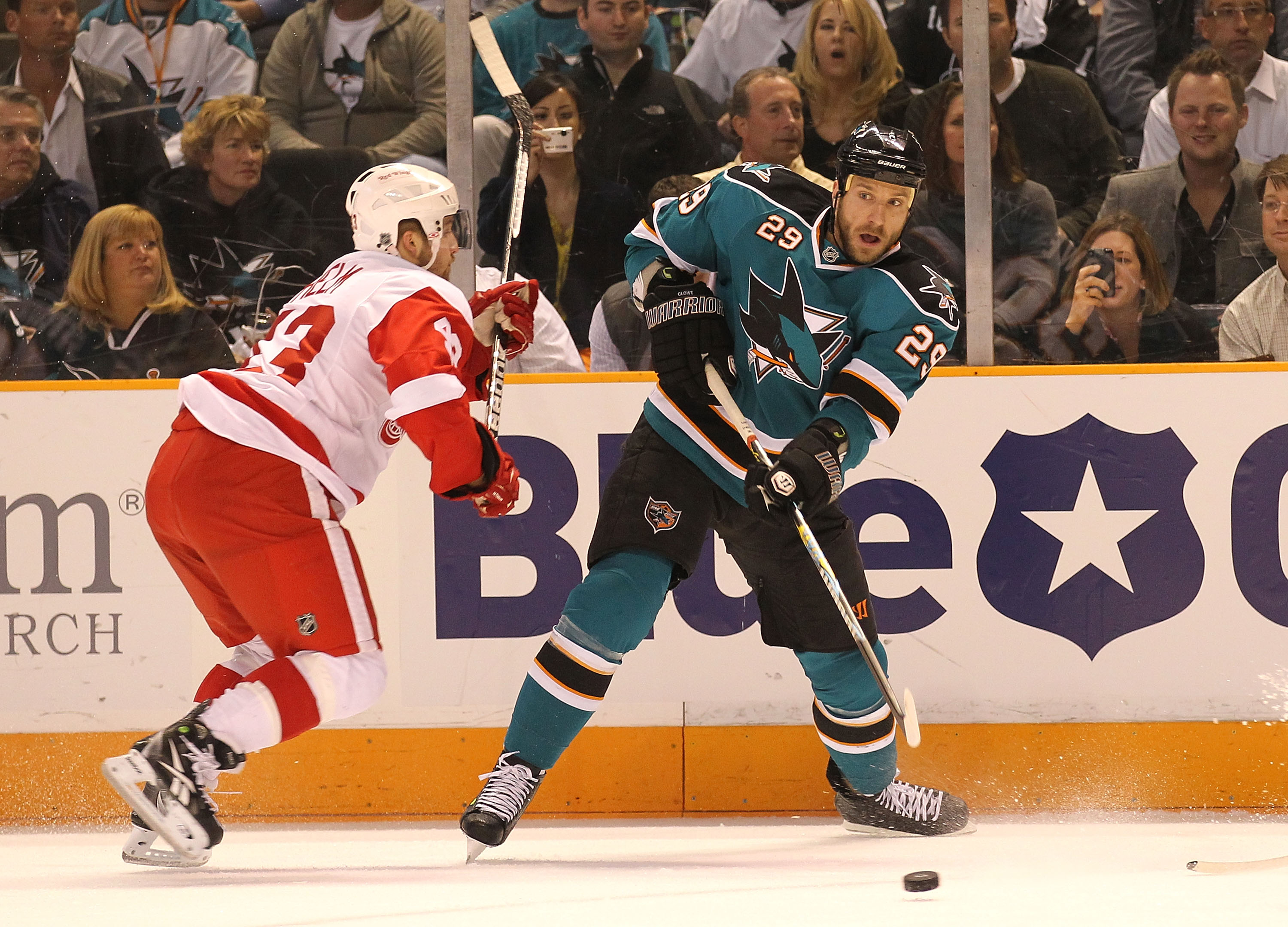 SAN JOSE, CA - MAY 8: Ryan Clowe #29 of the San Jose Sharks skates with the puck against Johan Franzen #93 of the Detroit Red Wings in Game Five of the Western Conference Semifinals during the 2010 NHL Stanley Cup Playoffs at HP Pavilion on May 8, 2010 in