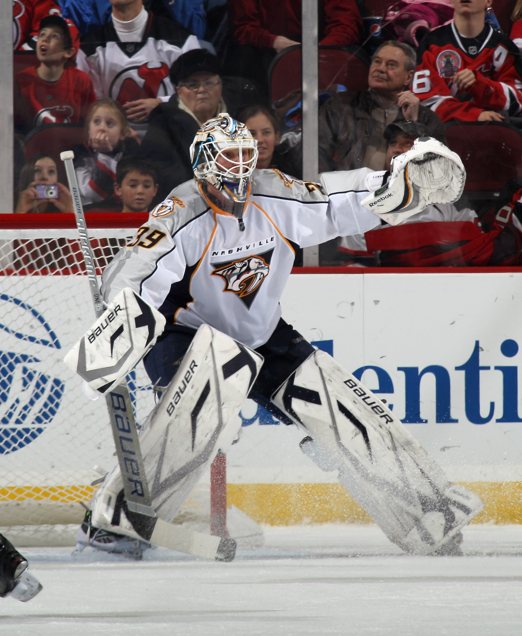 NEWARK, NJ - DECEMBER 17: Anders Lindback #39 of the Nashville Predators skates against the New Jersey Devils at the Prudential Center on December 17, 2010 in Newark, New Jersey.  (Photo by Bruce Bennett/Getty Images)