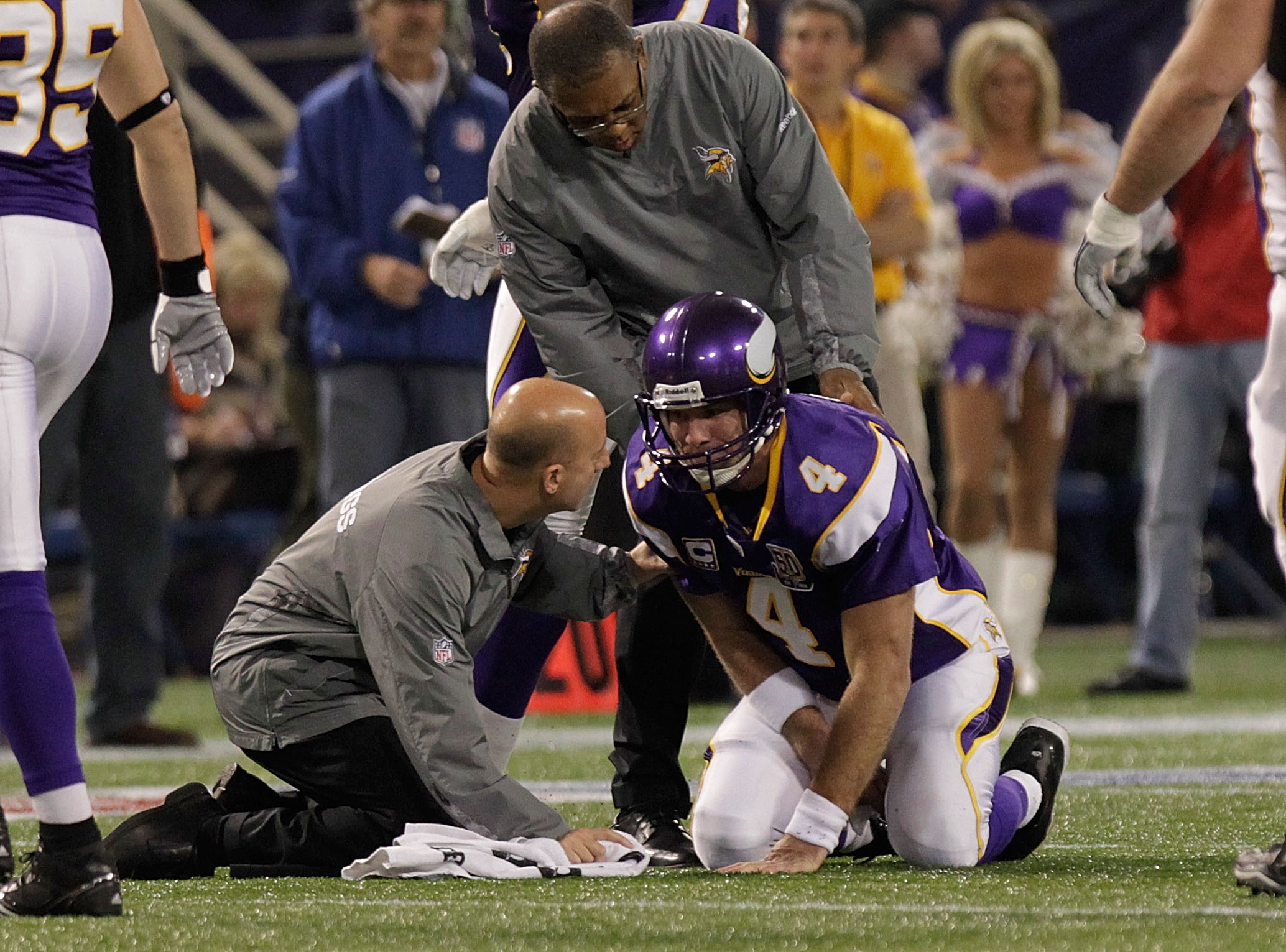 MINNEAPOLIS, MN - DECEMBER 05:  Brett Favre #4 of the Minnesota Vikings is assisted by medical staff against the Buffalo Bills defense at the Mall of America Field at the Hubert H. Humphrey Metrodome on December 5, 2010 in Minneapolis, Minnesota.  (Photo