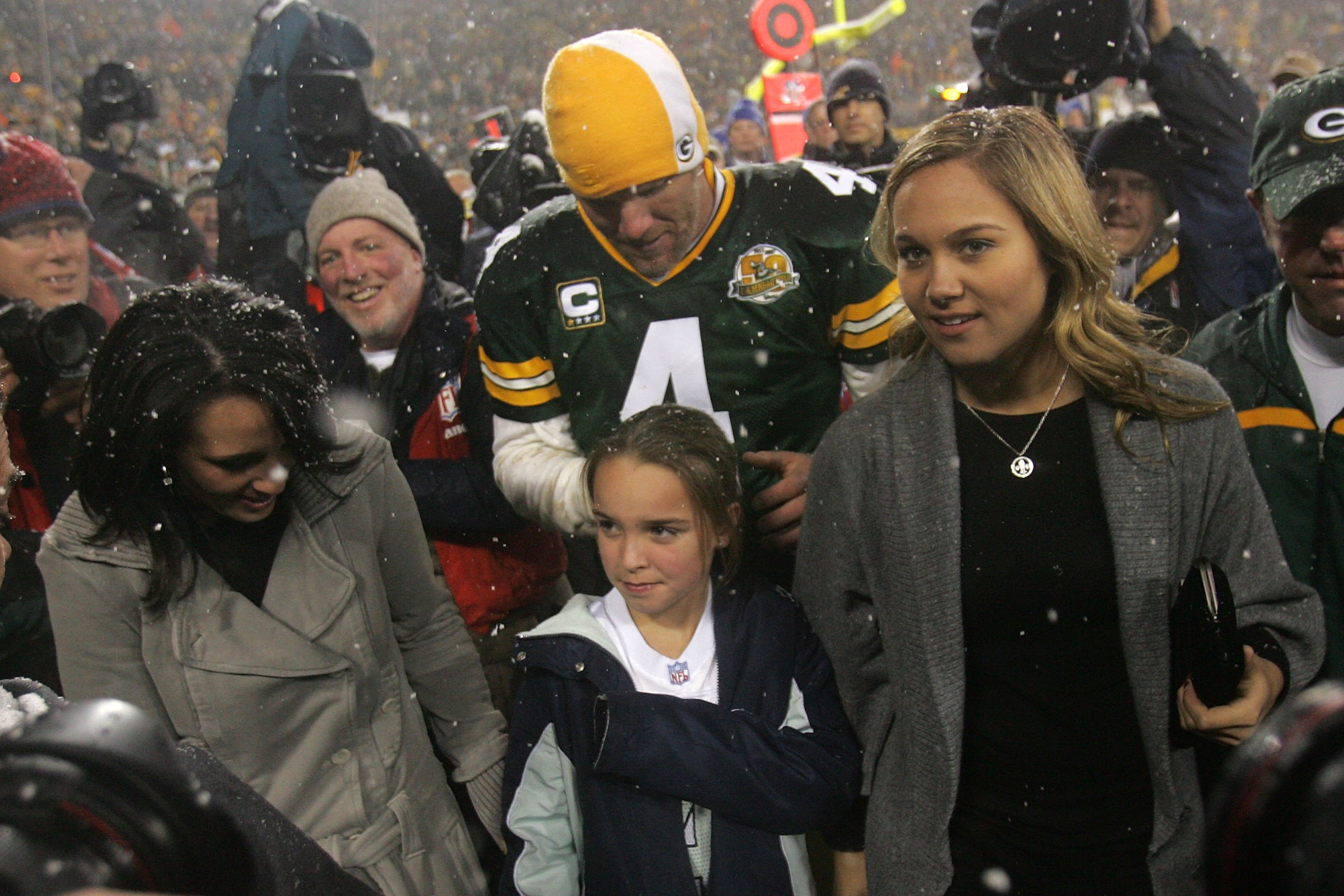 GREEN BAY, WI - JANUARY 12:  Quarterback Brett Favre #4 of the Green Bay Packers walks off the field with his wife Deanna and daughters (R) Brittany and (M) Breleigh after the Packers defeated the Seattle Seahawks 42-20 after the NFC divisional playoff ga