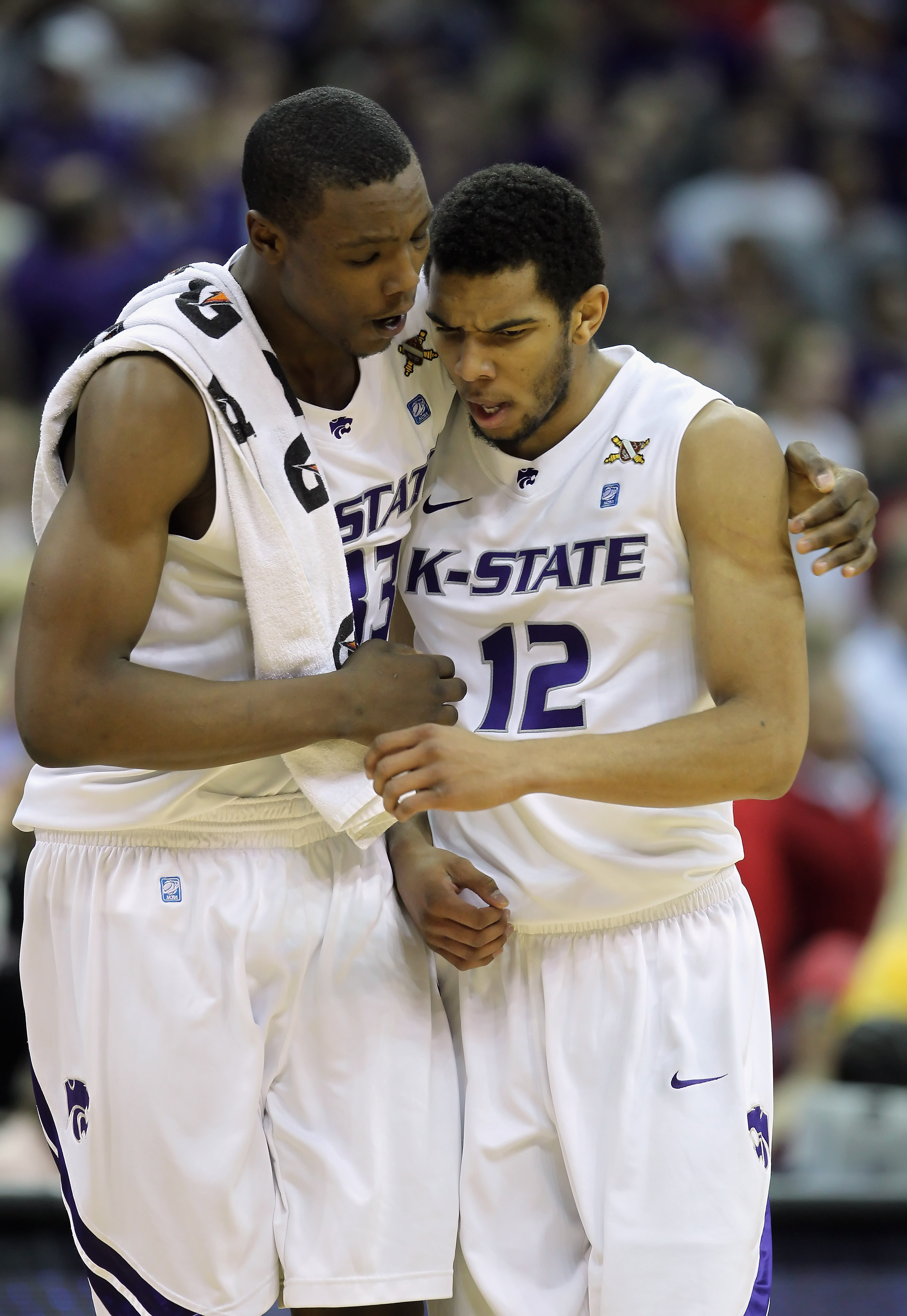 KANSAS CITY, MO - DECEMBER 21:  Nick Russell #12 of the Kansas State Wildcats is hugged by Wally Judge #33 during the game against the UNLV Rebels on December 21, 2010 at the Sprint Center in Kansas City, Missouri.  (Photo by Jamie Squire/Getty Images)