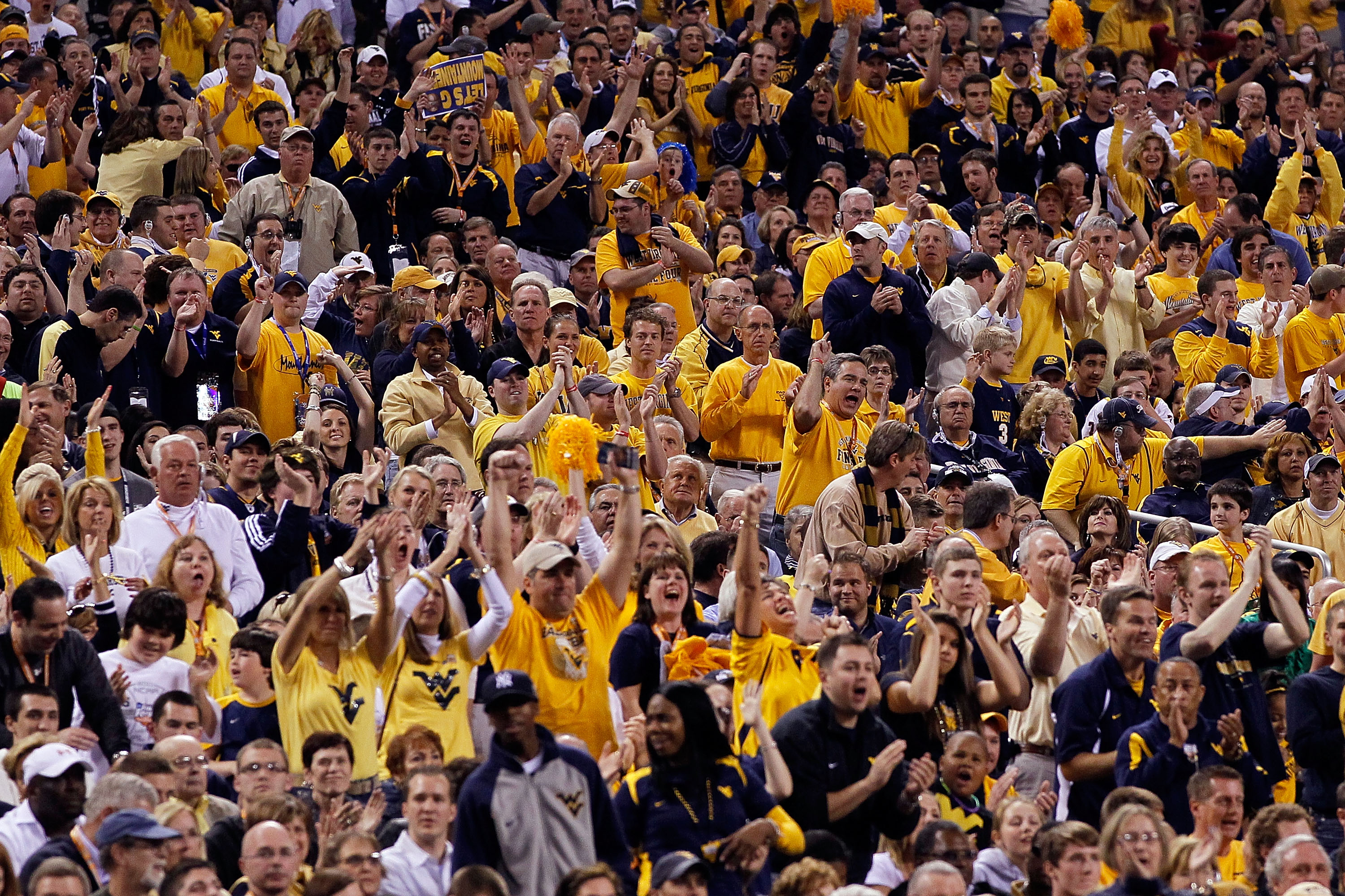 INDIANAPOLIS - APRIL 03:  Fans of the West Virginia Mountaineers cheer on their team in the first half against the Duke Blue Devils during the National Semifinal game of the 2010 NCAA Division I Men's Basketball Championship at Lucas Oil Stadium on April
