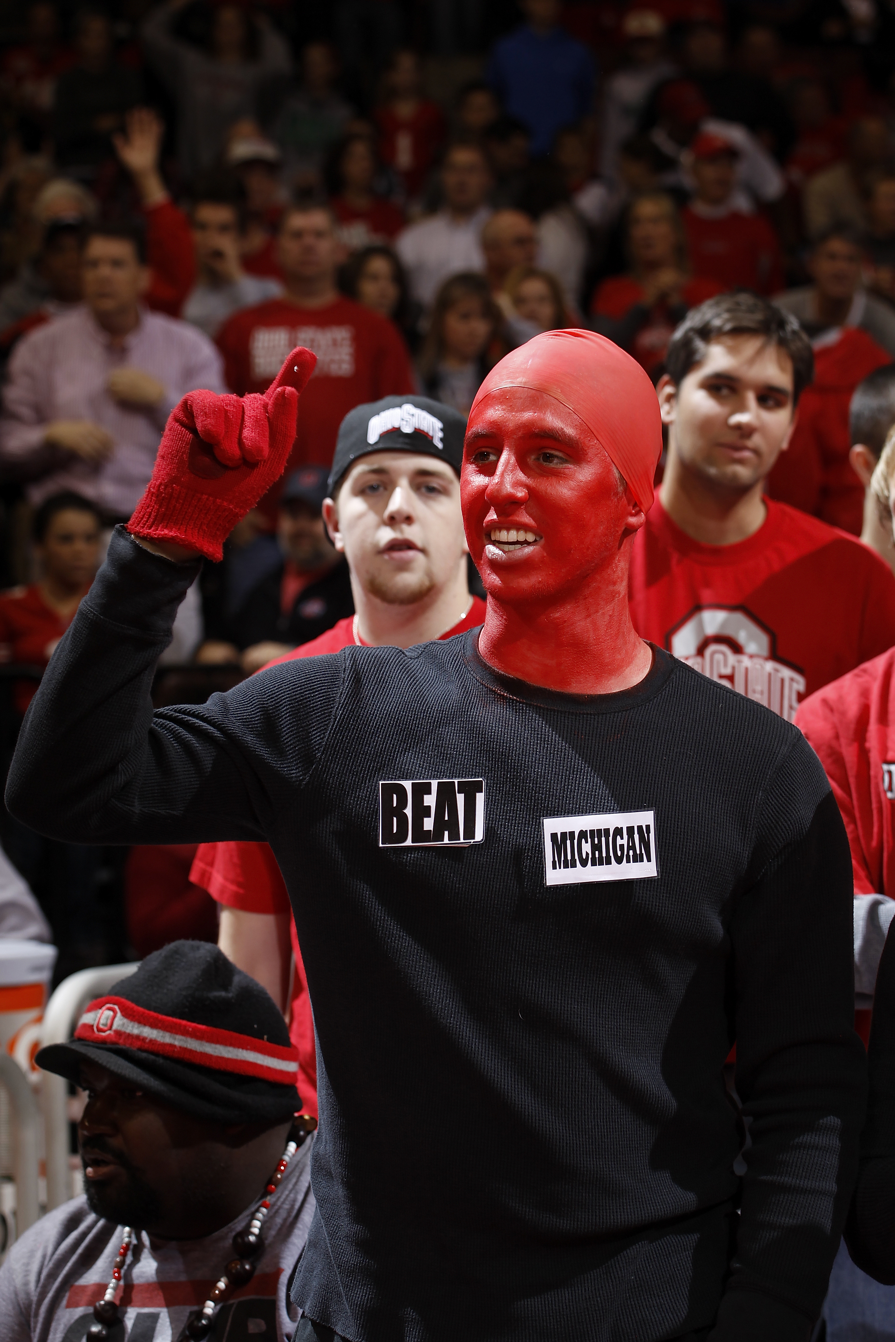 COLUMBUS, OH - NOVEMBER 26: An Ohio State Buckeyes fan wears a shirt with reference to Saturday's Michigan at Ohio State football rivalry game cheers during the game against the Miami RedHawks at Value City Arena on November 26, 2010 in Columbus, Ohio. Oh