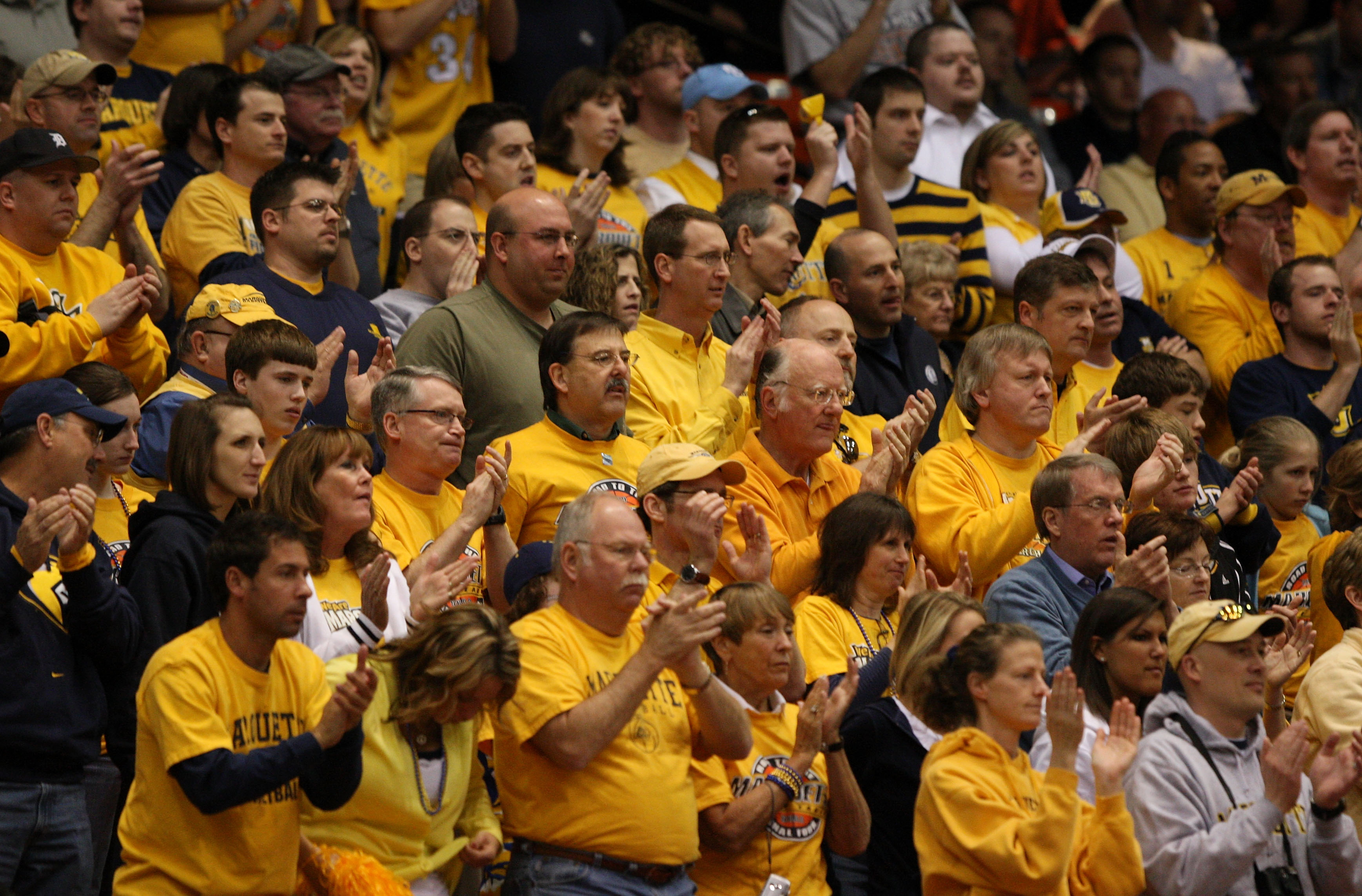 BOISE, ID - MARCH 20:  Fans of the Marquette Golden Eagles cheer during the game against the Utah State Aggies in the first round of the NCAA Division I Men's Basketball Tournament at the Taco Bell Arena on March 20, 2009 in Boise, Idaho.  (Photo by Jed J