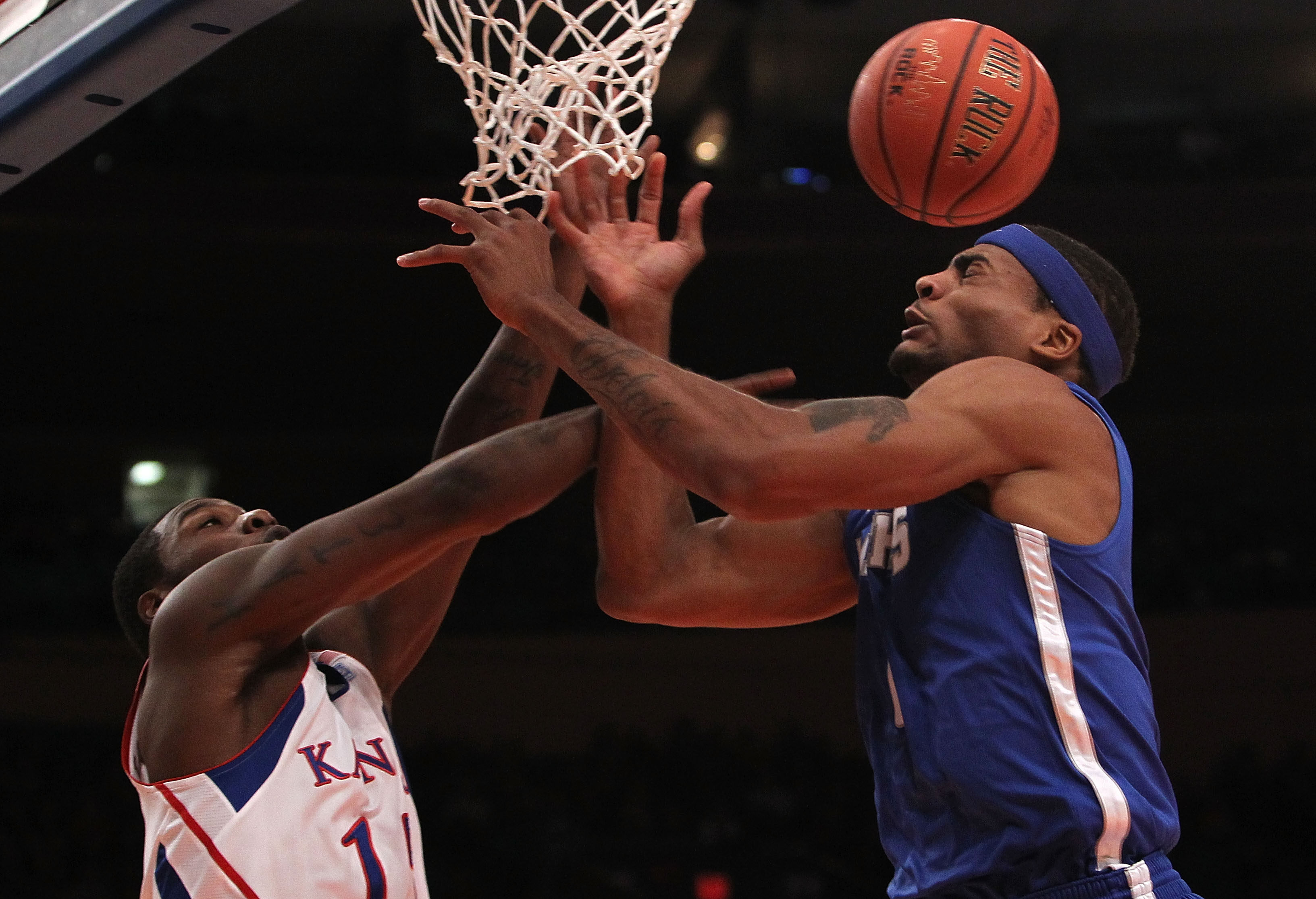 NEW YORK, NY - DECEMBER 07:  Will Coleman #0 of the Memphis Tigers contests a rebound with Elijah Johnson #15 of the Kansas Jayhawks during their game at the Jimmy V Classic at Madison Square Garden on December 7, 2010 in New York City.  (Photo by Nick La