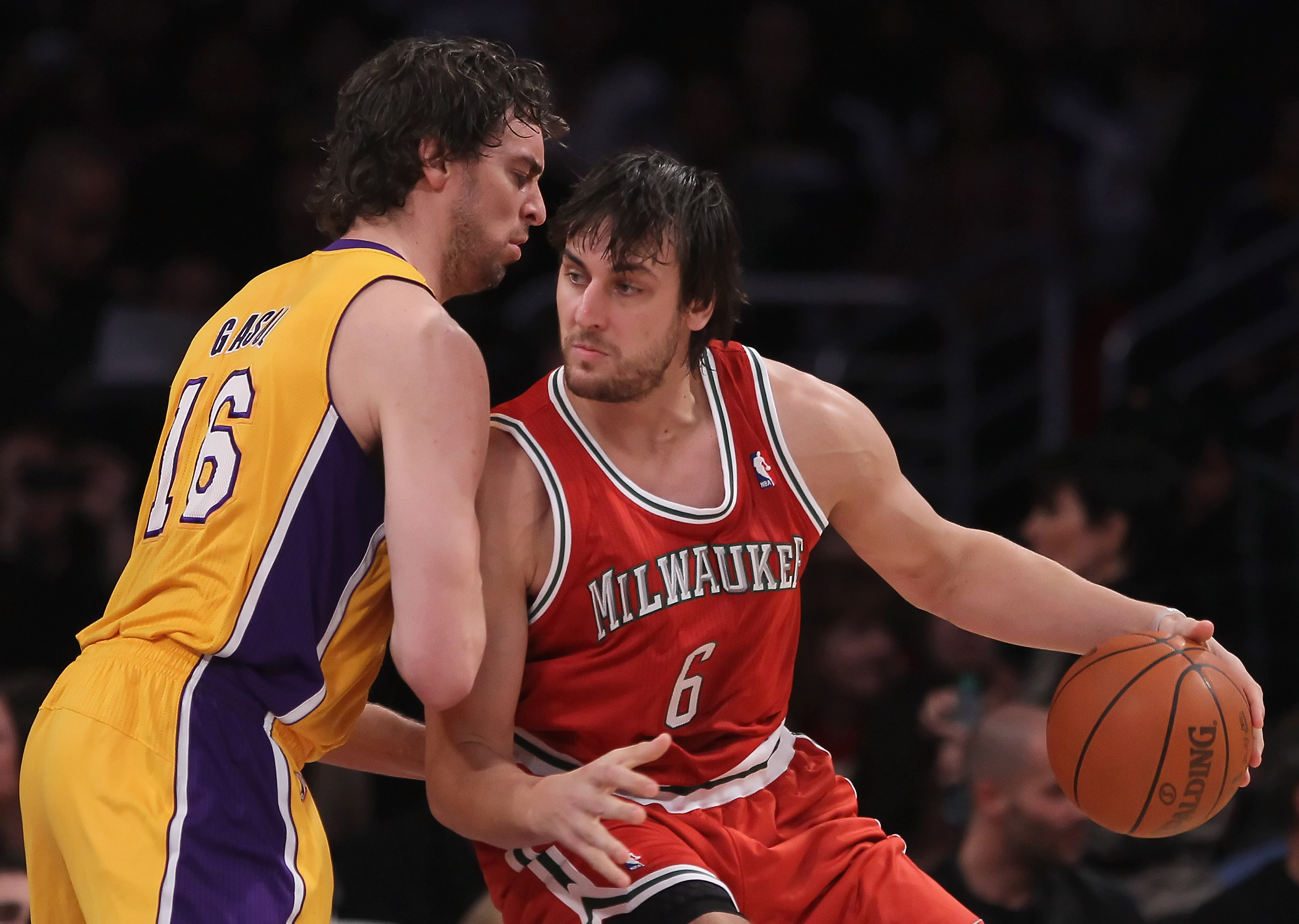 LOS ANGELES, CA - DECEMBER 21:  Pau Gasol #16 of the Los Angeles Lakers defends Andrew Bogut #6 of the Milwaukee Bucks during the first half at Staples Center on December 21, 2010 in Los Angeles, California. The Bucks defeated the Lakers 98-79. NOTE TO US