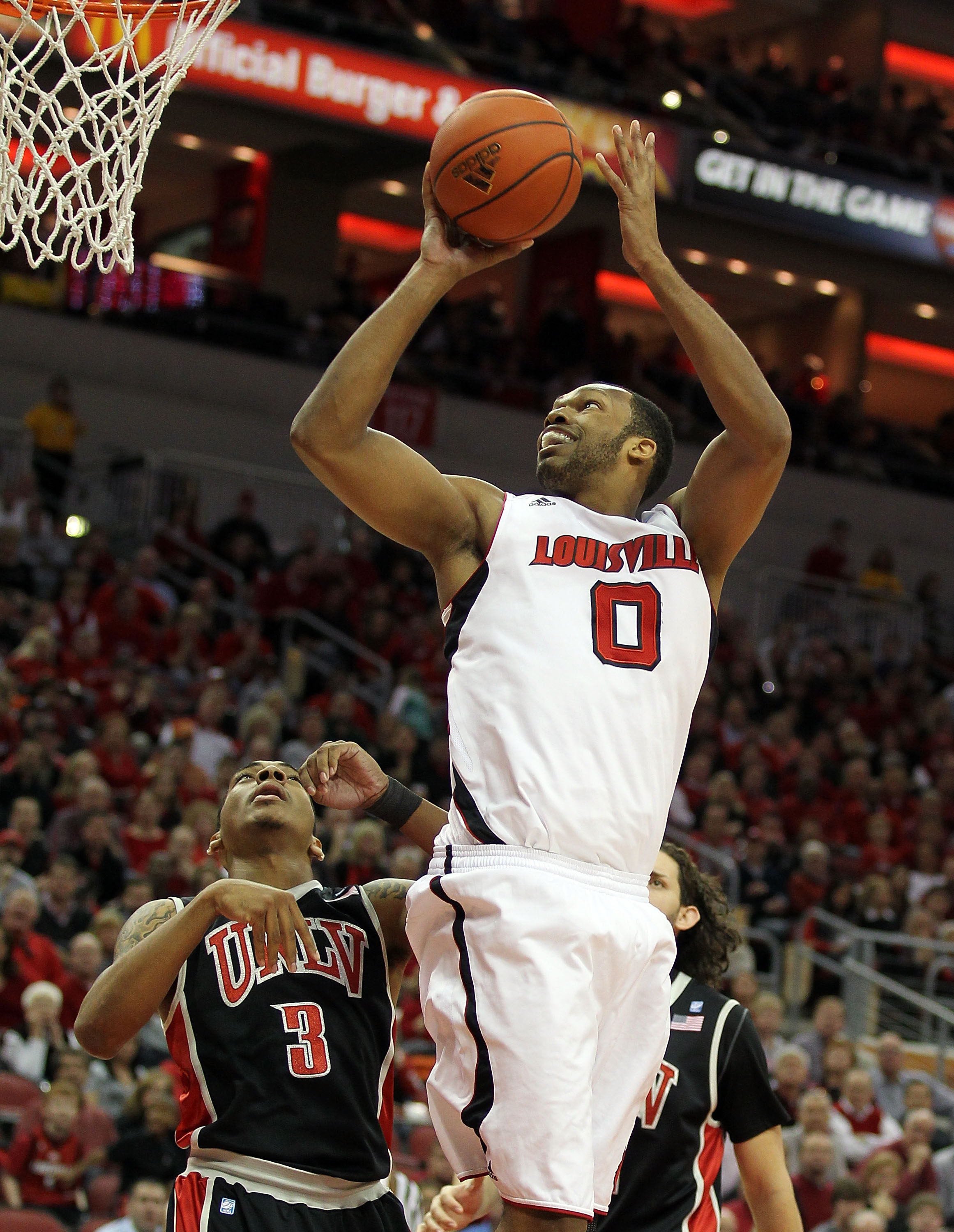 LOUISVILLE, KY - DECEMBER 11:  George Goode#0 of the Louisville Cardinals shoots the ball during the game against the UNLV Runnin' Rebels at KFC YUM! Center on December 11, 2010 in Louisville, Kentucky.  (Photo by Andy Lyons/Getty Images)