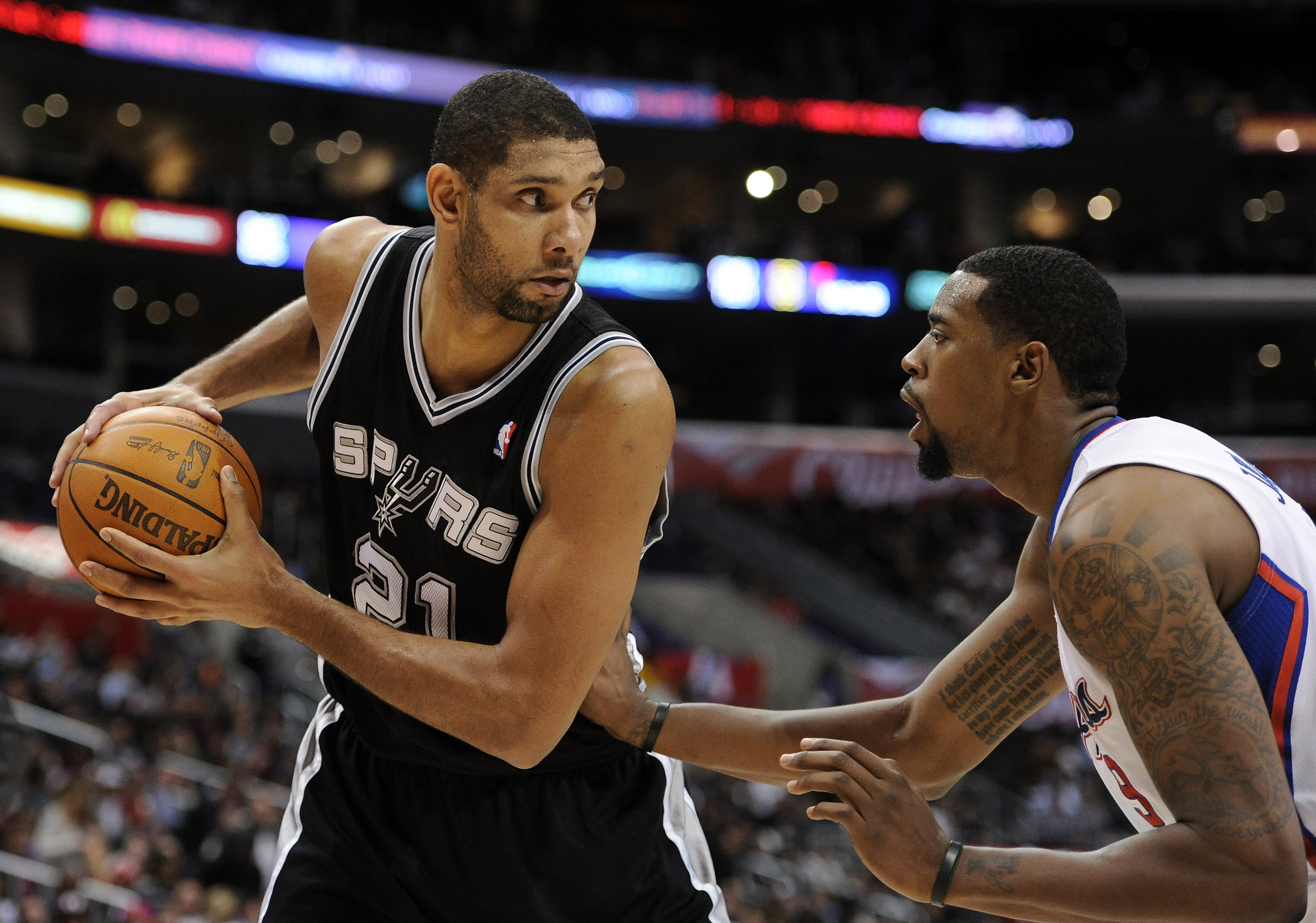 LOS ANGELES, CA - DECEMBER 01:  Tim Duncan #21 of the San Antonio Spurs pauses with the ball in front of DeAndre Jordan #9 of the Los Angeles Clippers at the Staples Center on December 1, 2010 in Los Angeles, California.  NOTE TO USER: User expressly ackn