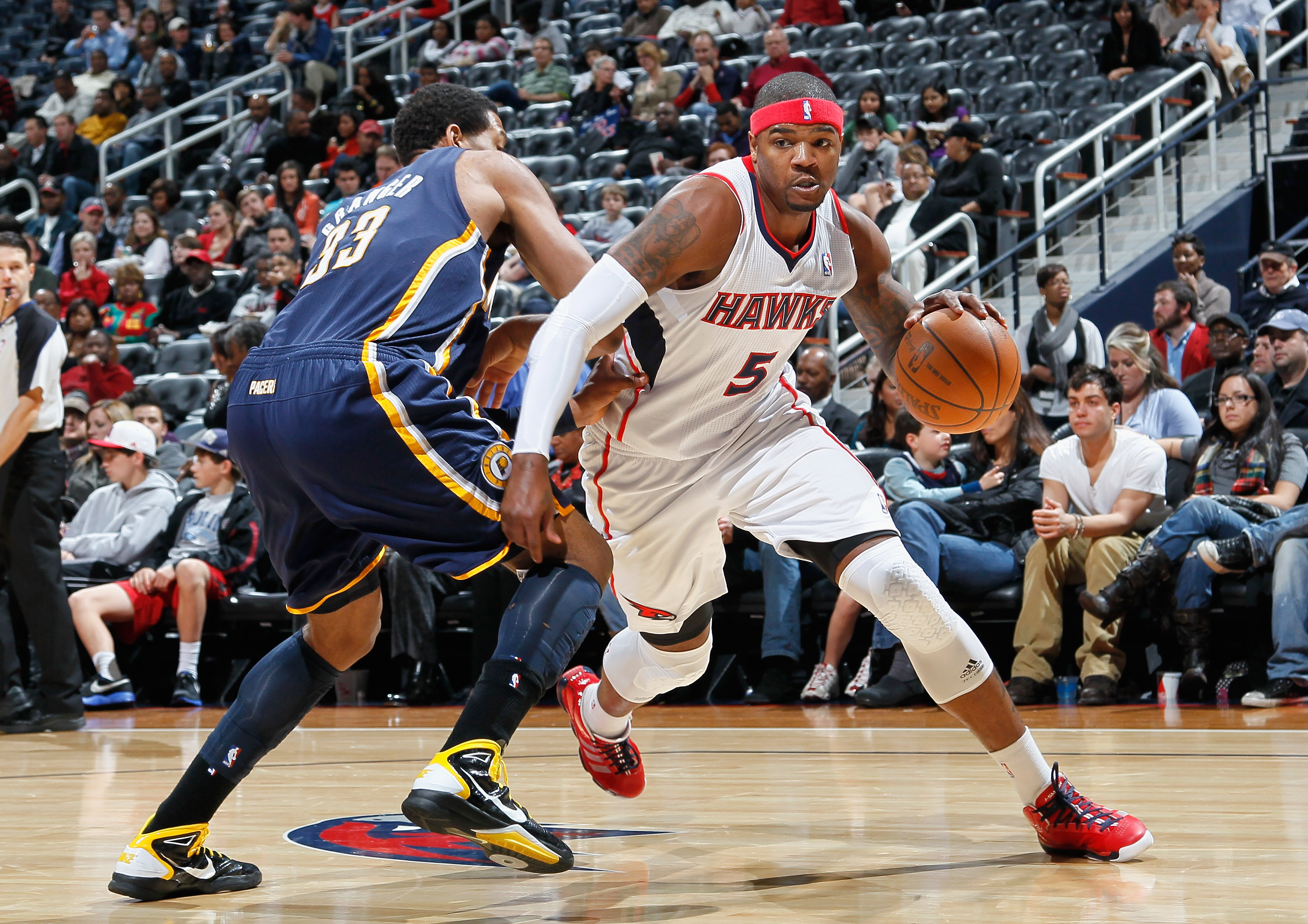 ATLANTA, GA - DECEMBER 11:  Josh Smith #5 of the Atlanta Hawks against Danny Granger #33 of the Indiana Pacers at Philips Arena on December 11, 2010 in Atlanta, Georgia.  NOTE TO USER: User expressly acknowledges and agrees that, by downloading and/or usi