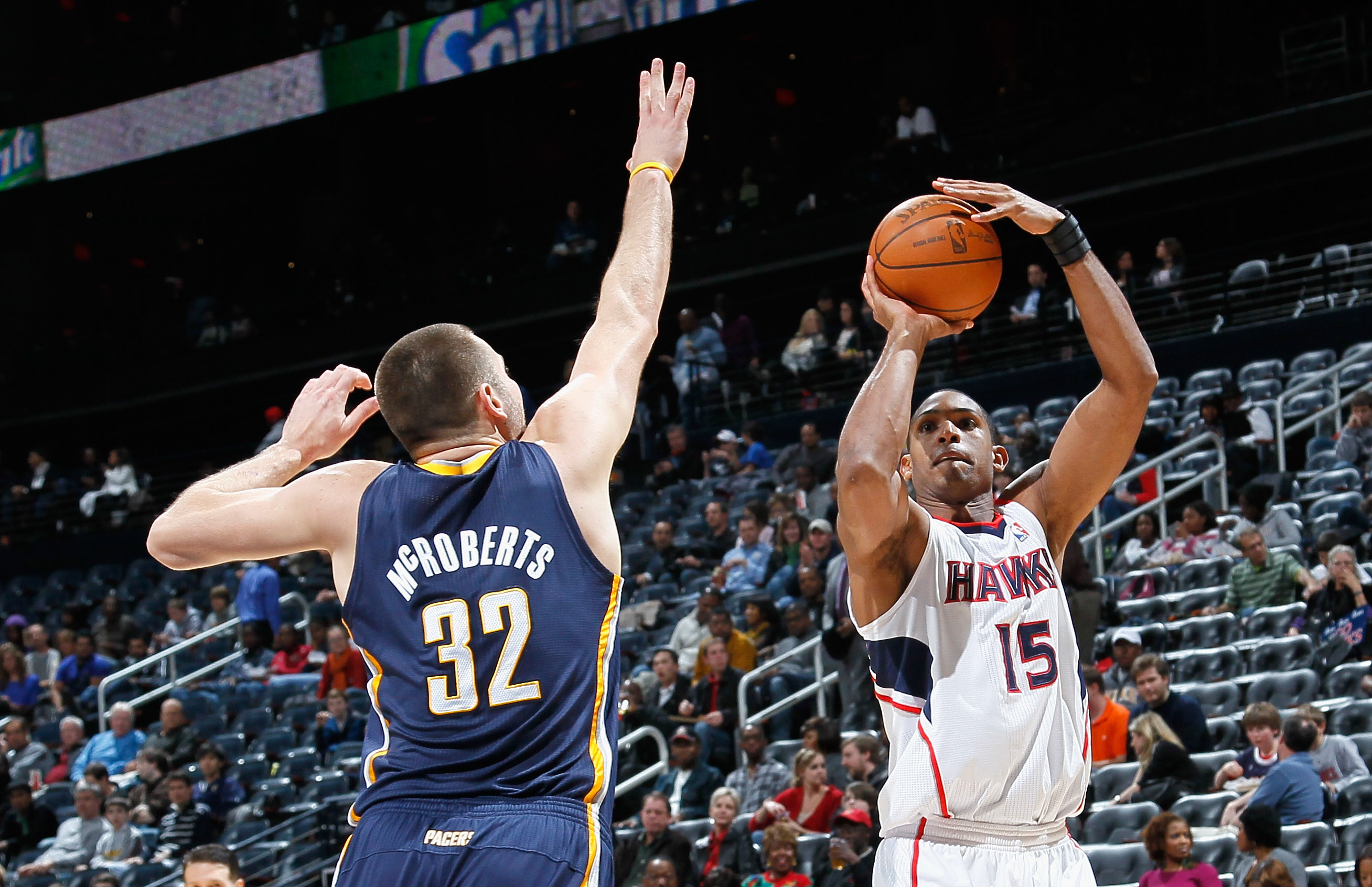 ATLANTA, GA - DECEMBER 11:  Al Horford #15 of the Atlanta Hawks against Josh McRoberts #32 of the Indiana Pacers at Philips Arena on December 11, 2010 in Atlanta, Georgia.  NOTE TO USER: User expressly acknowledges and agrees that, by downloading and/or u