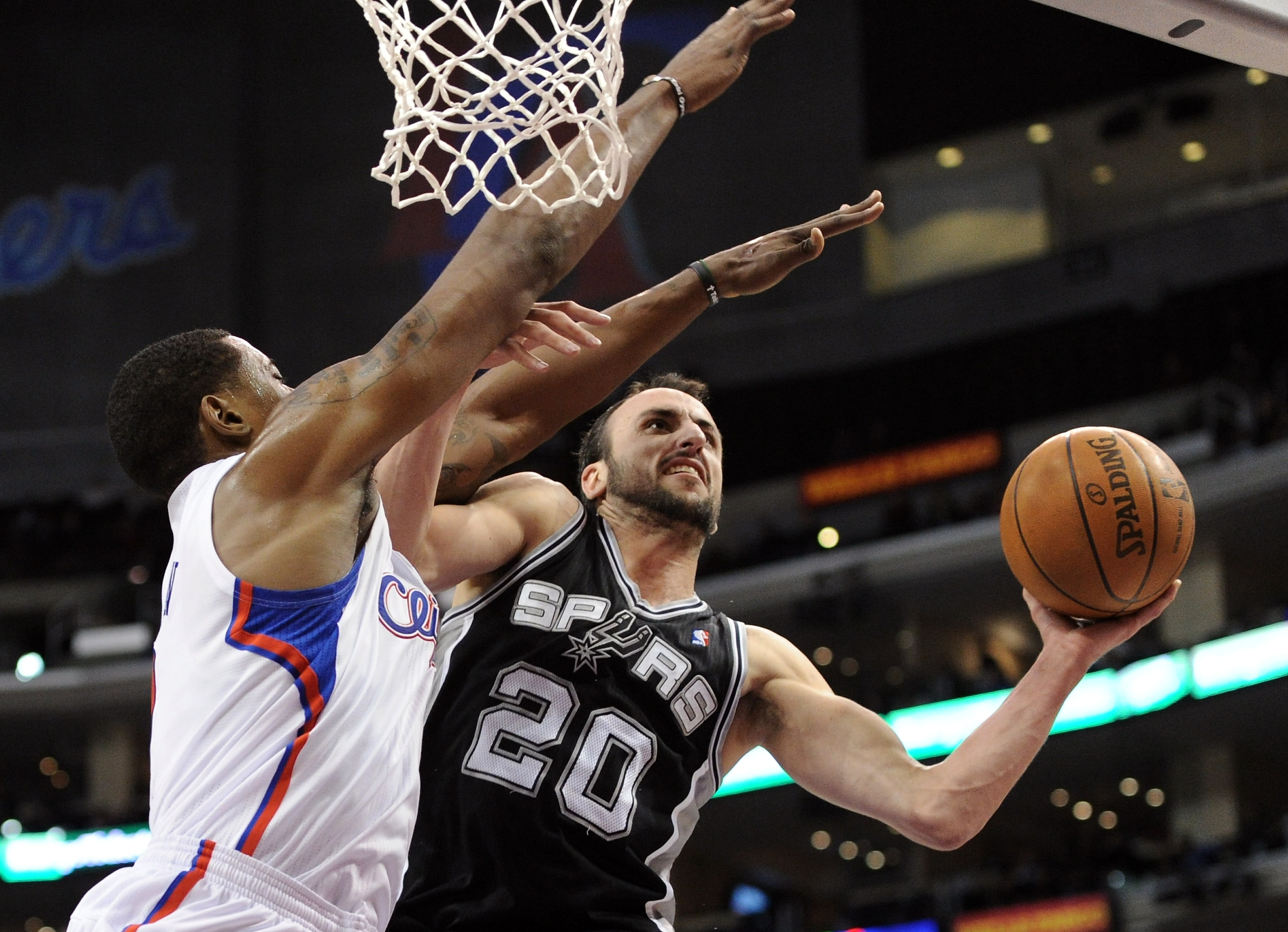 LOS ANGELES, CA - DECEMBER 01:  Manu Ginobili #20 of the San Antonio Spurs attempts a shot over the defense of DeAndre Jordan #9 of the Los Angeles Clippers during a 90-85 Clipper win at the Staples Center on December 1, 2010 in Los Angeles, California.