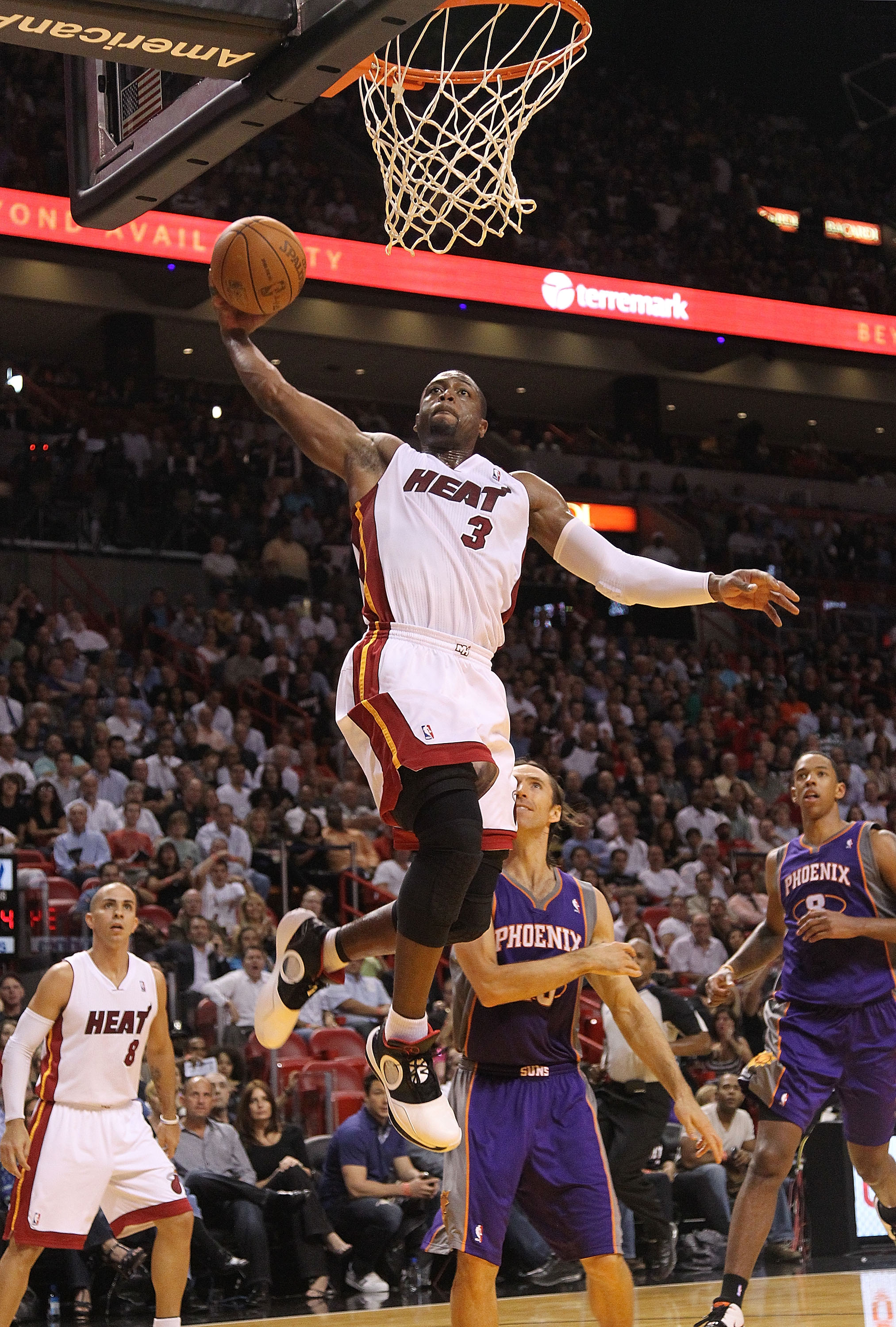 MIAMI - NOVEMBER 17:  Dwyane Wade #3 of the Miami Heat dunks during a game against the Phoenix Suns at American Airlines Arena on November 17, 2010 in Miami, Florida. NOTE TO USER: User expressly acknowledges and agrees that, by downloading and/or using t