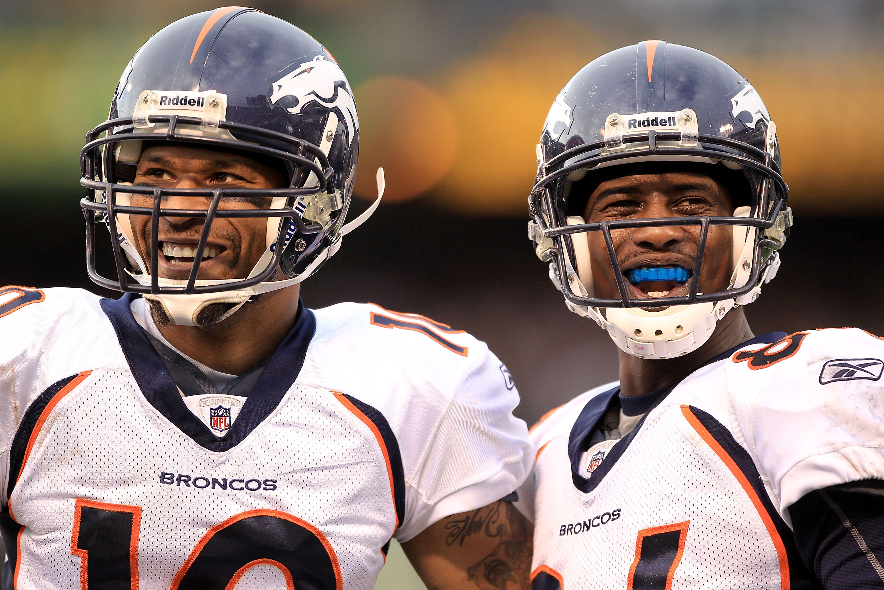 OAKLAND, CA - DECEMBER 19:  Jabar Gaffney #10 (left) and Brandon Lloyd #84 of the Denver Broncos smile at the Raider fans during their game against the Oakland Raiders at Oakland-Alameda County Coliseum on December 19, 2010 in Oakland, California.  (Photo