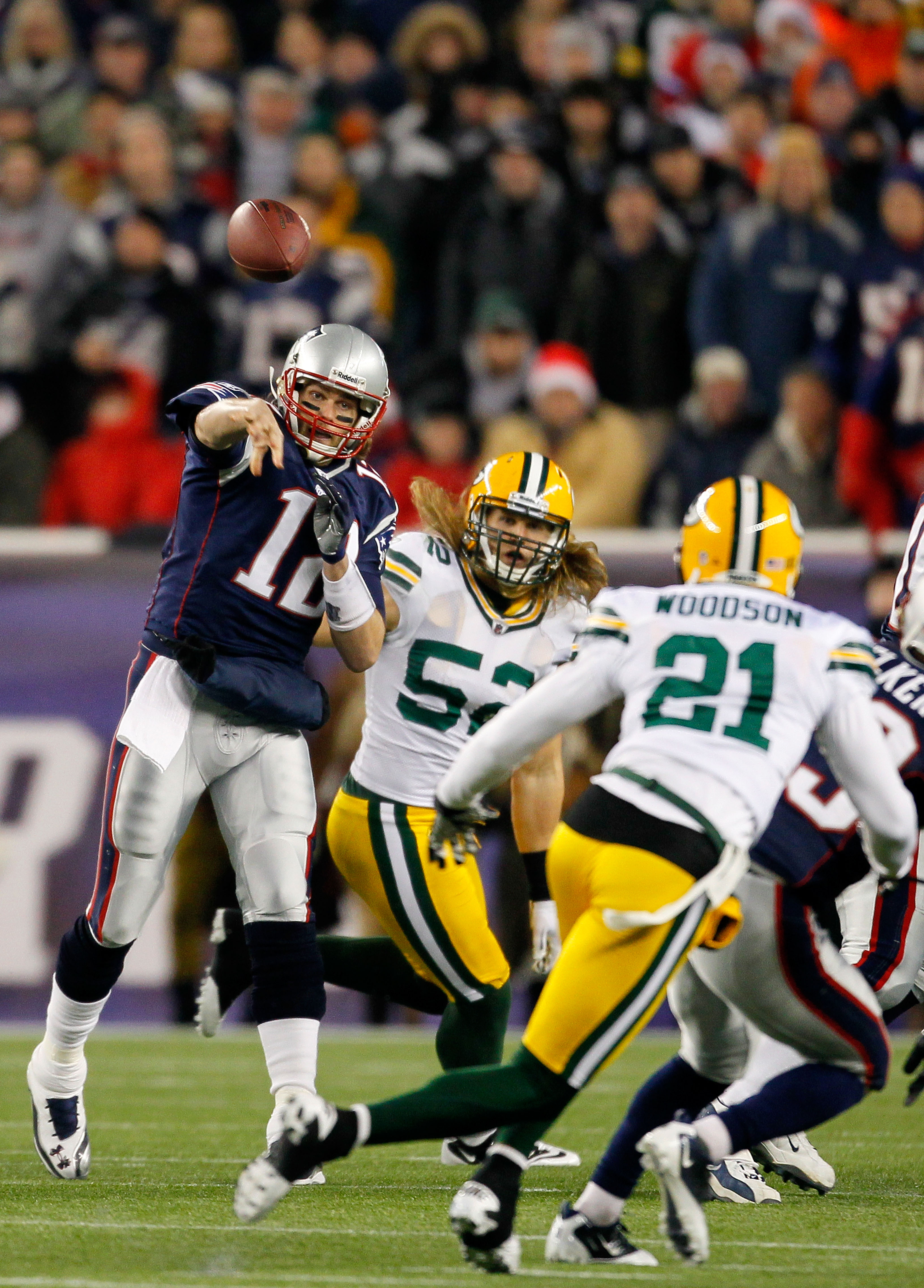 FOXBORO, MA - DECEMBER 19:  Quarterback Tom Brady #12 of the New England Patriots throws a pass against the Green Bay Packers in the first quarter of the game at Gillette Stadium on December 19, 2010 in Foxboro, Massachusetts.  (Photo by Jim Rogash/Getty