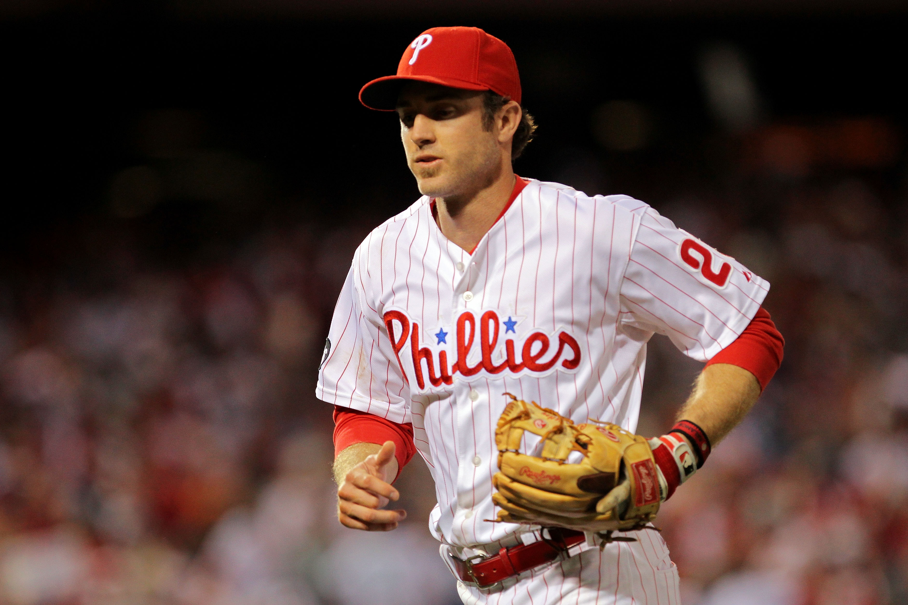 PHILADELPHIA - OCTOBER 23:  Chase Utley #26 of the Philadelphia Phillies runs off the field after turing a double play against the San Francisco Giants in Game Six of the NLCS during the 2010 MLB Playoffs at Citizens Bank Park on October 23, 2010 in Phila