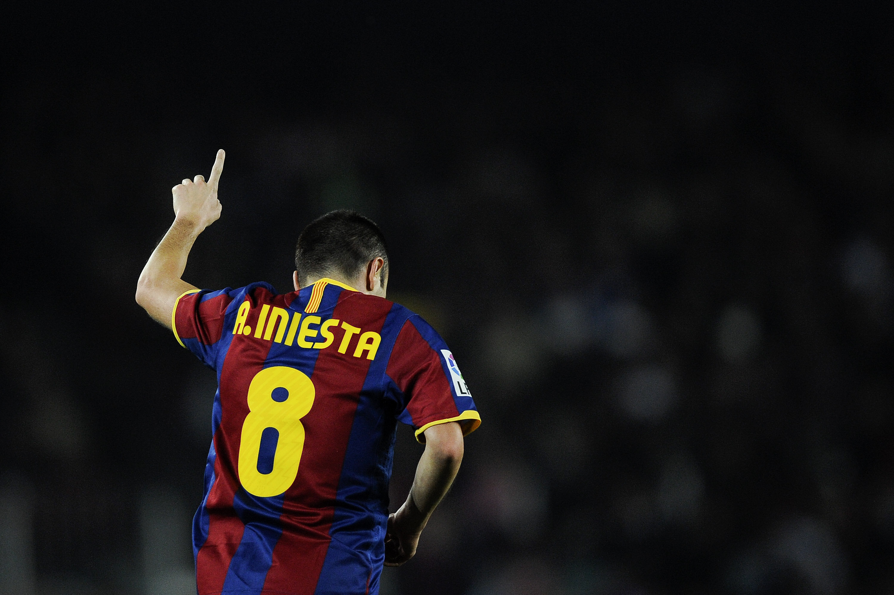 BARCELONA, SPAIN - DECEMBER 12:  Andres Iniesta of Barcelona celebrates after scoring his goal during the La Liga match between Barcelona and Real Sociedad at Camp Nou Stadium on December 12, 2010 in Barcelona, Spain. Barcelona won 5-0.  (Photo by David R