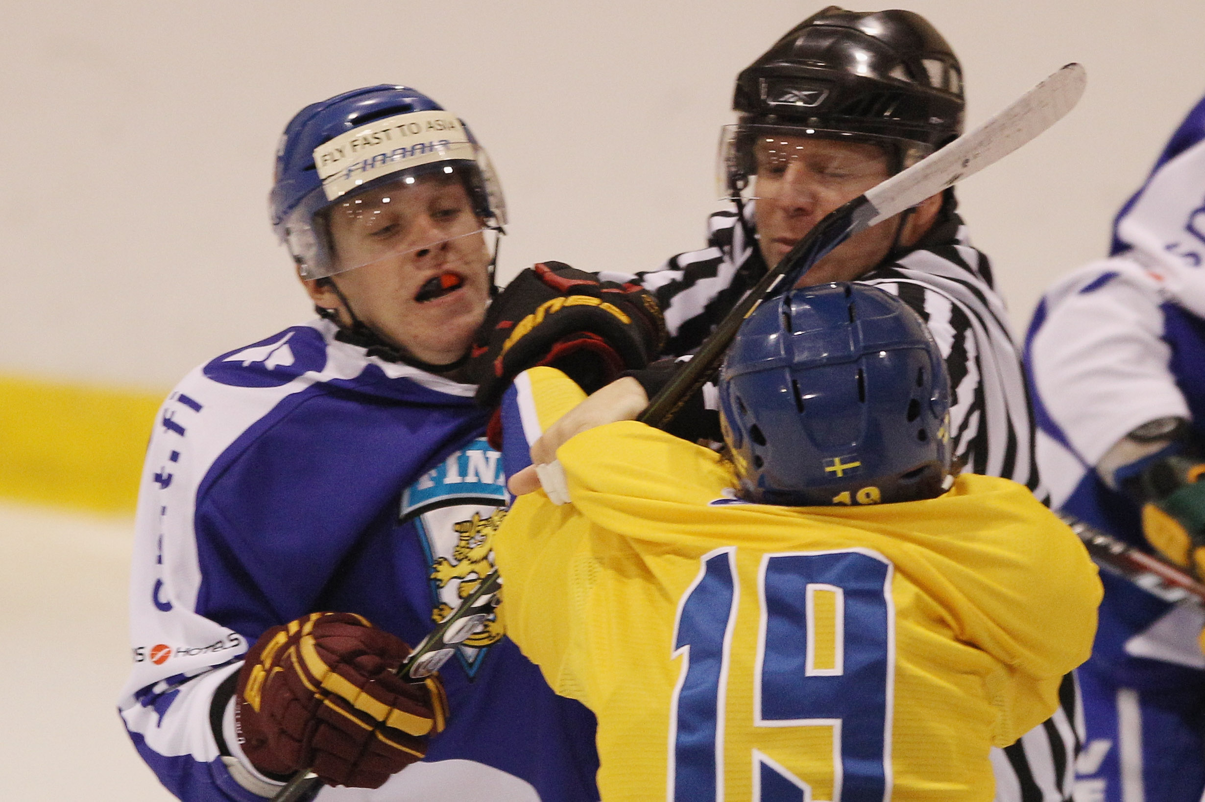 LAKE PLACID, NY - AUGUST 05: Erik Haula #10 of Team Finland is hit by Calle Jarnkrok #19 of Team Sweden at the USA Hockey National Evaluation Camp on August 5, 2010 in Lake Placid, New York.  (Photo by Bruce Bennett/Getty Images)
