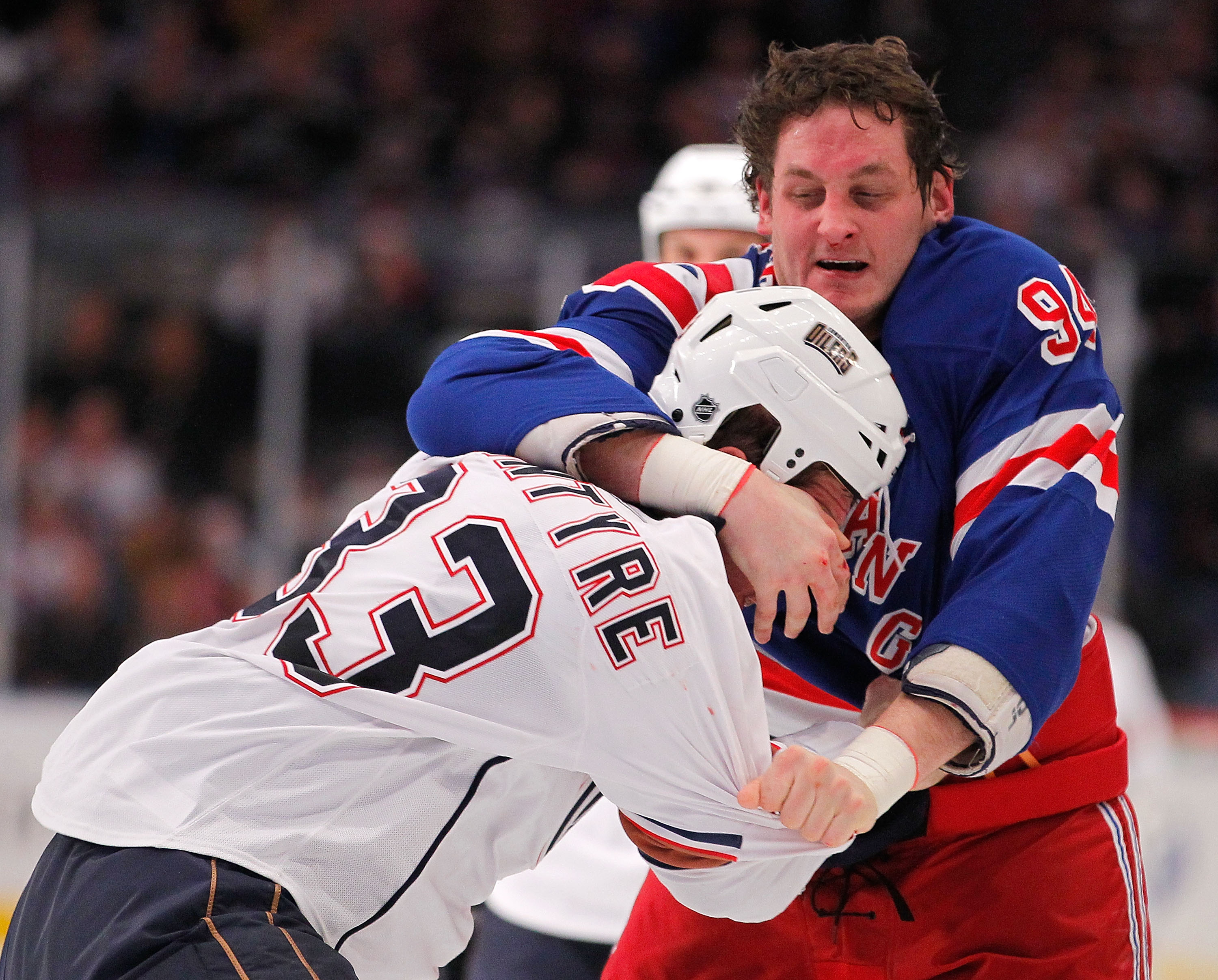 NEW YORK - NOVEMBER 14:  Steve MacIntyre #33 of the Edmonton Oilers fighting with Derek Boogaard #94 of the New York Rangers during a hockey game at Madison Square Garden on November 14, 2010 in New York City.  (Photo by Paul Bereswill/Getty Images)