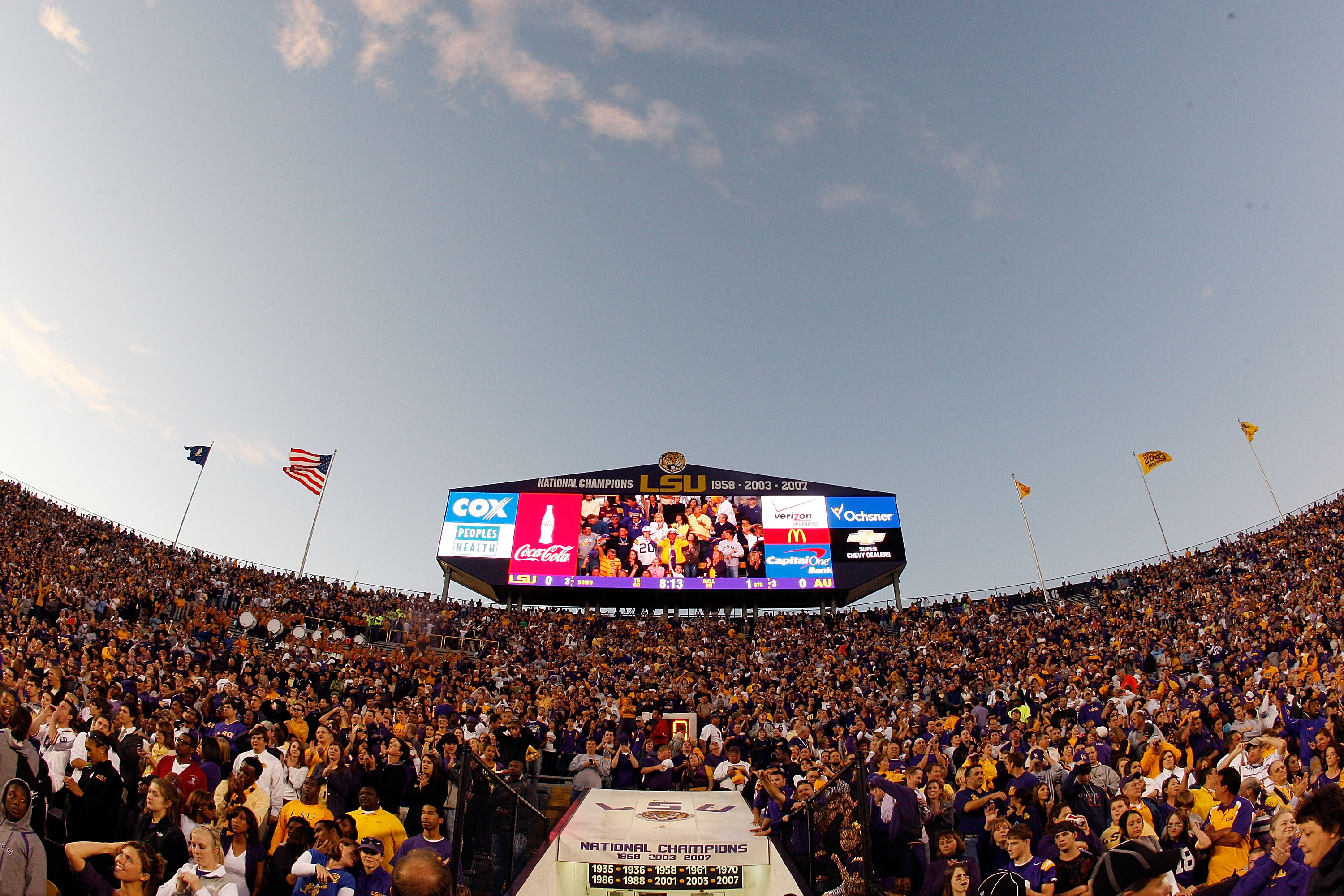 BATON ROUGE, LA - OCTOBER 24:  Fans of the Louisiana State University Tigers cheer during pregame before playing  the Auburn Tigers at Tiger Stadium on October 24, 2009 in Baton Rouge, Louisiana.  (Photo by Chris Graythen/Getty Images)