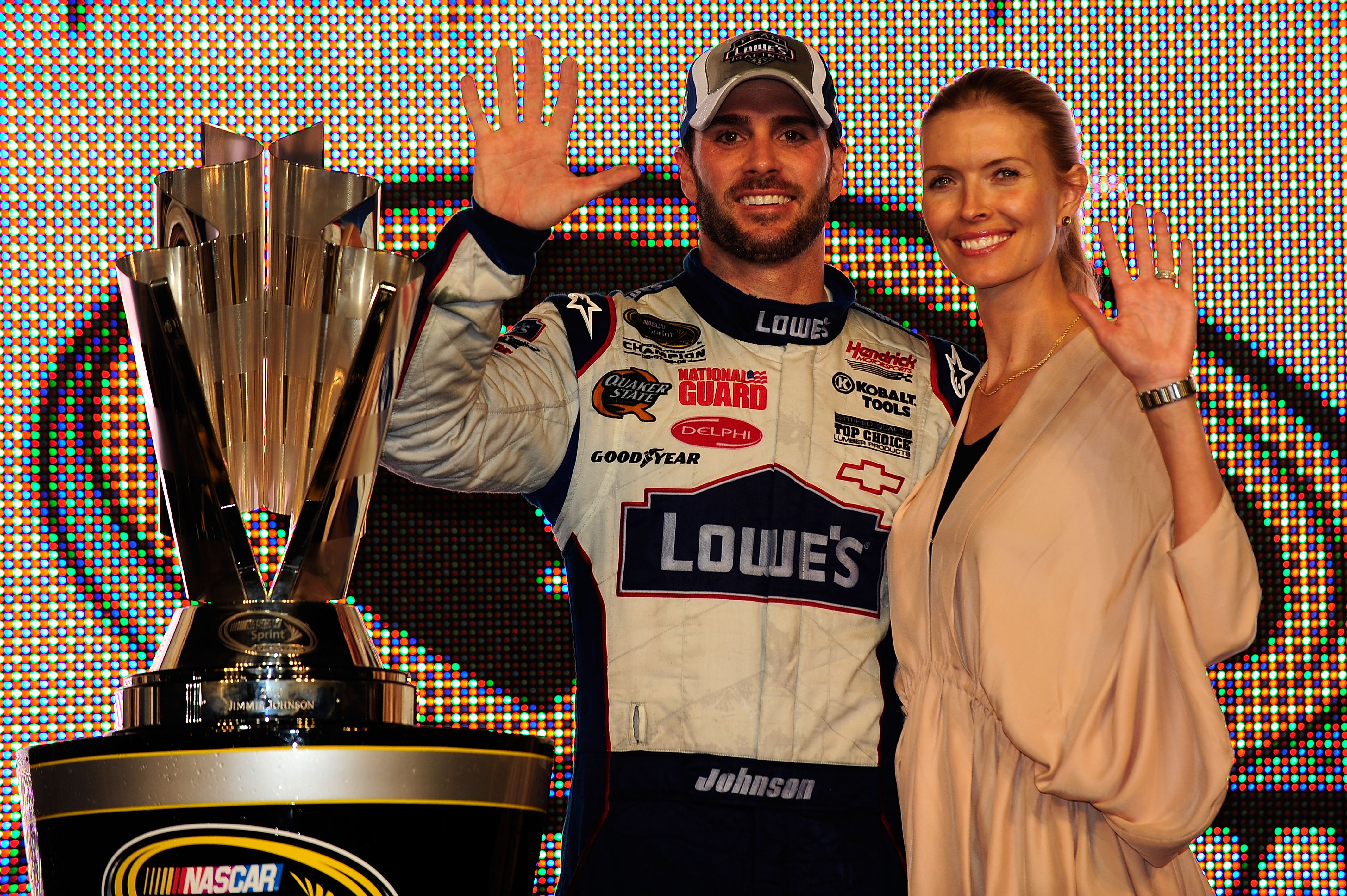 HOMESTEAD, FL - NOVEMBER 21:  Jimmie Johnson (L), driver of the #48 Lowe's Chevrolet, poses with his wife Chandra after finishing in second place in the Ford 400 to clinch his fifth consecutive NASCAR Sprint Cup championship at Homestead-Miami Speedway on