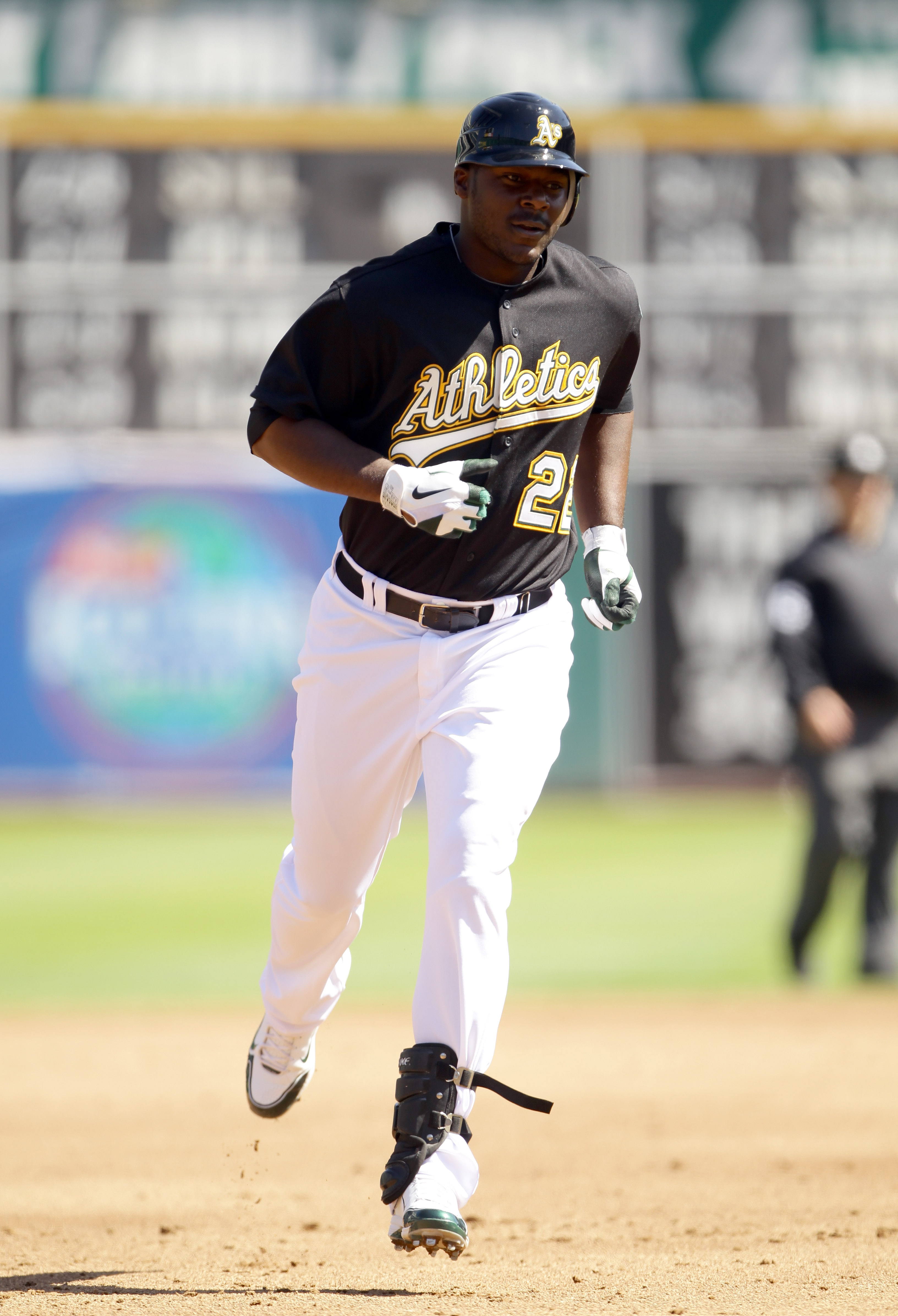 OAKLAND, CA - SEPTEMBER 22:  Chris Carter #22 of the Oakland Athletics rounds the bases after hitting his first major league home run against the Chicago White Sox at the Oakland-Alameda County Coliseum on September 22, 2010 in Oakland, California.  (Phot