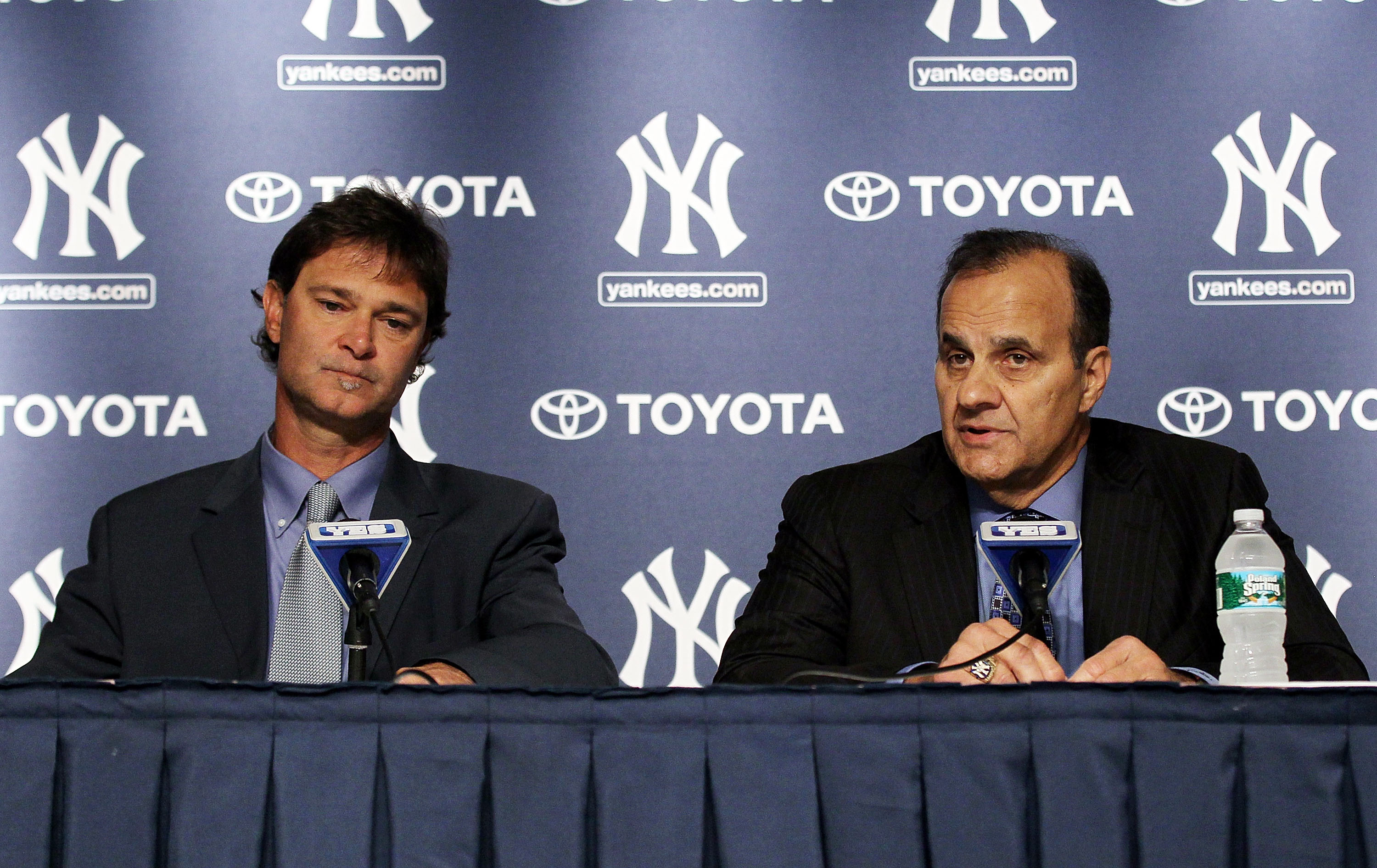 NEW YORK - SEPTEMBER 20:  Former New York Yankees manager Joe Torre (R) and former player Don Mattingly speak to the media prior to the game against the Tampa Bay Rays on September 20, 2010 at Yankee Stadium in the Bronx borough of New York City.  (Photo
