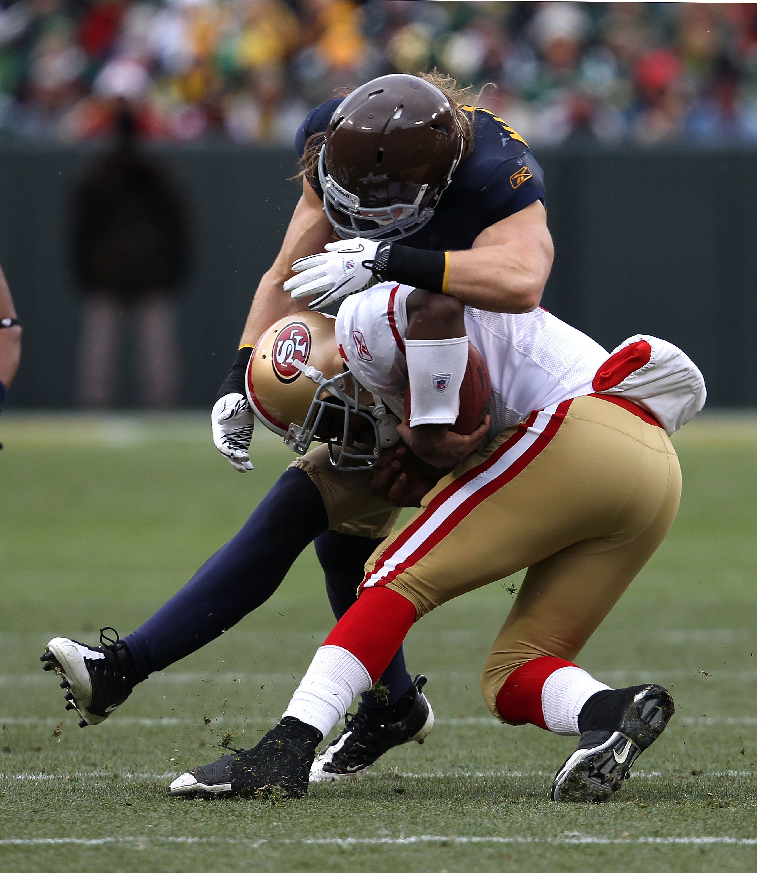 GREEN BAY, WI - DECEMBER 05: Troy Smith #1 of the San Francisco 49ers is tackled by Clay Matthews #52 of the Green Bay Packers at Lambeau Field on December 5, 2010 in Green Bay, Wisconsin. The Packers defeated the 49ers 34-16. (Photo by Jonathan Daniel/Ge