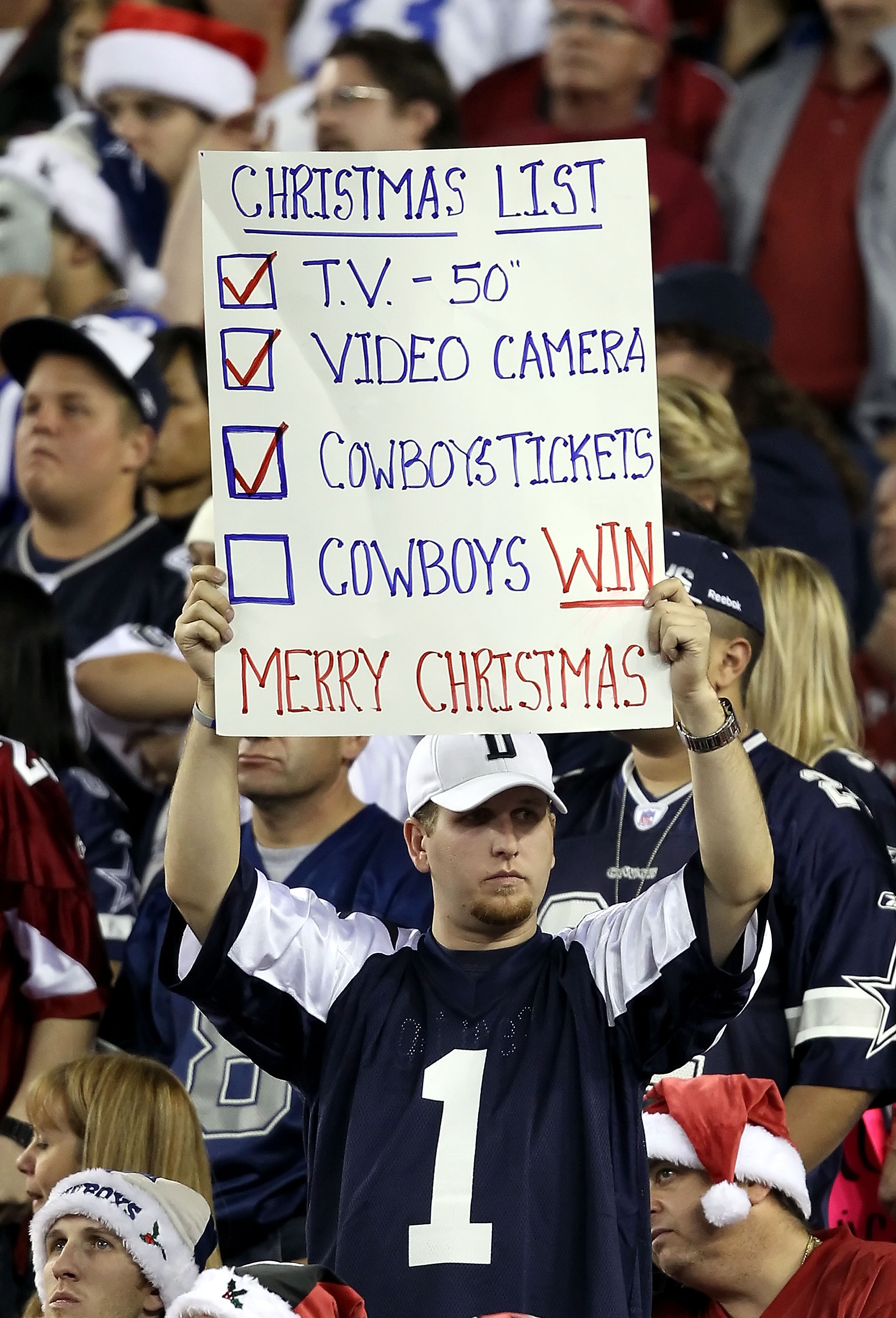GLENDALE, AZ - DECEMBER 25:  A fan of the Dallas Cowboys holds up a sign during the NFL game against the Arizona Cardinals at the University of Phoenix Stadium on December 25, 2010 in Glendale, Arizona.  The Cardinals defeated the Cowboys 27-26.  (Photo b