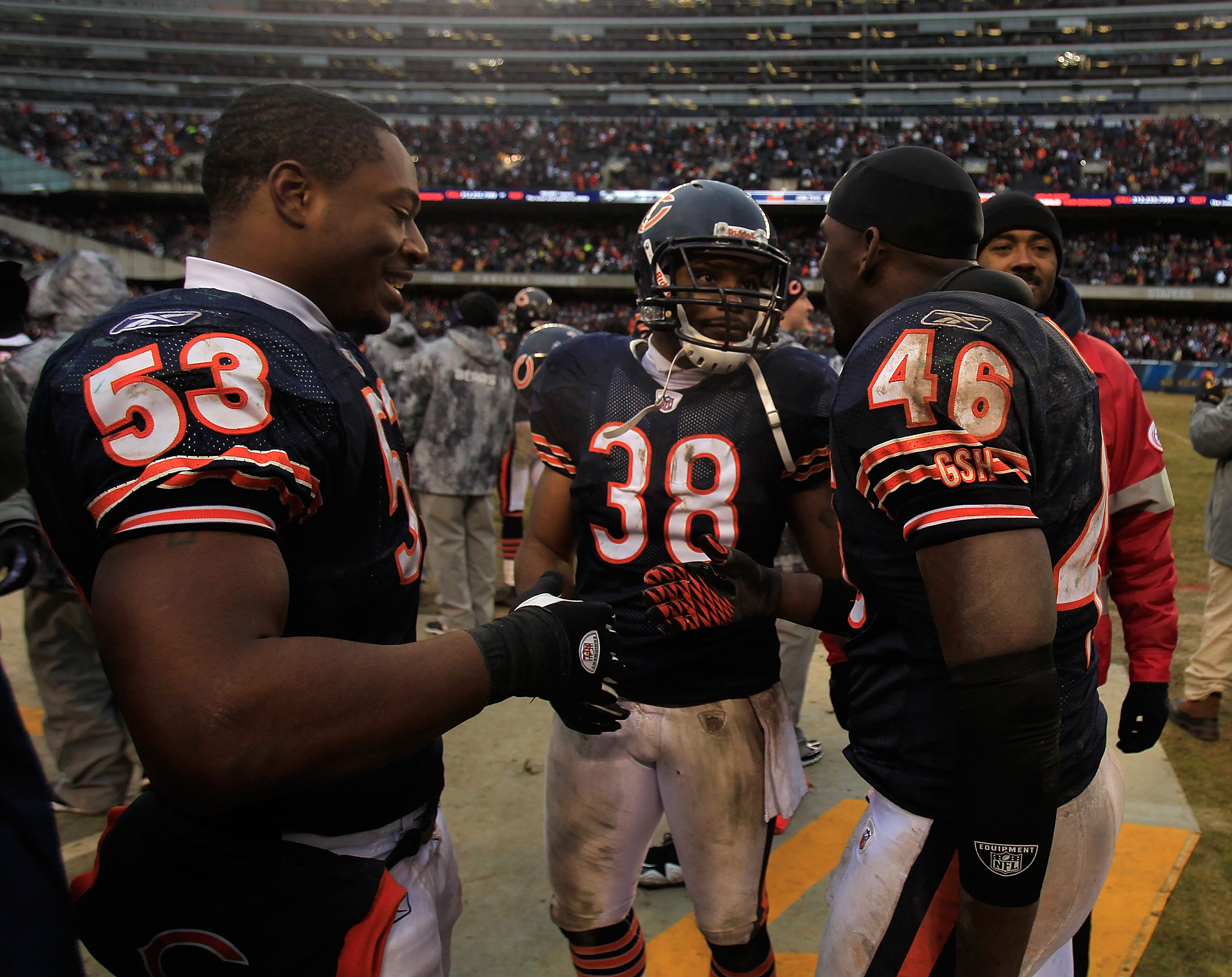 CHICAGO, IL - DECEMBER 26: Chris Harris #46 of the Chicago Bears is congratulated by teammates Nick Roach #53 and Danieal Manning #38 after intercepting a pass in the final minute against the New York Jets at Soldier Field on December 26, 2010 in Chicago,