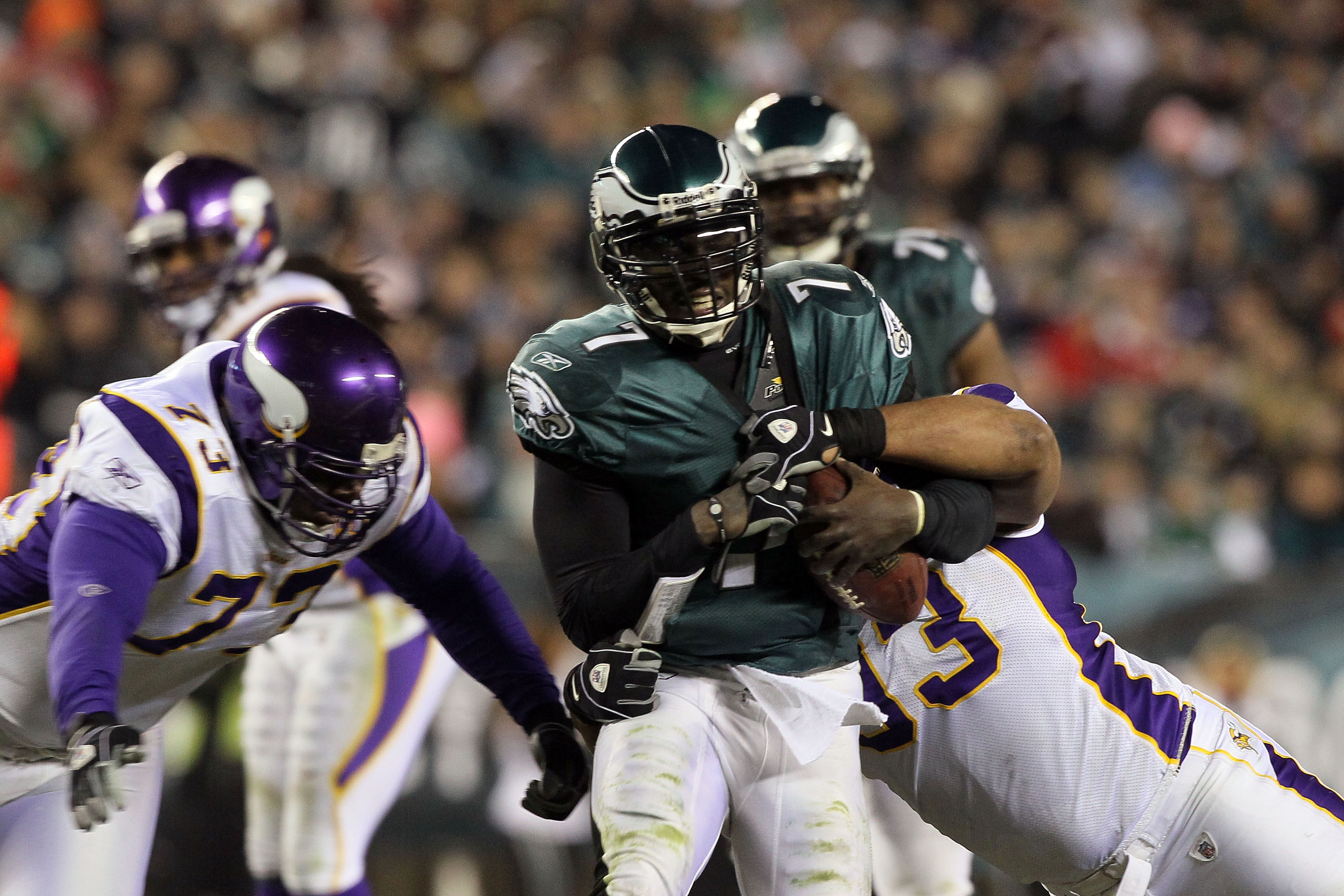 PHILADELPHIA, PA - DECEMBER 26:  Jamarca Sanford #33 of the Minnesota Vikings tackles Michael Vick #7 of the Philadelphia Eagles to cause a fumble in the 3rd quarter at Lincoln Financial Field on December 26, 2010 in Philadelphia, Pennsylvania.  (Photo by
