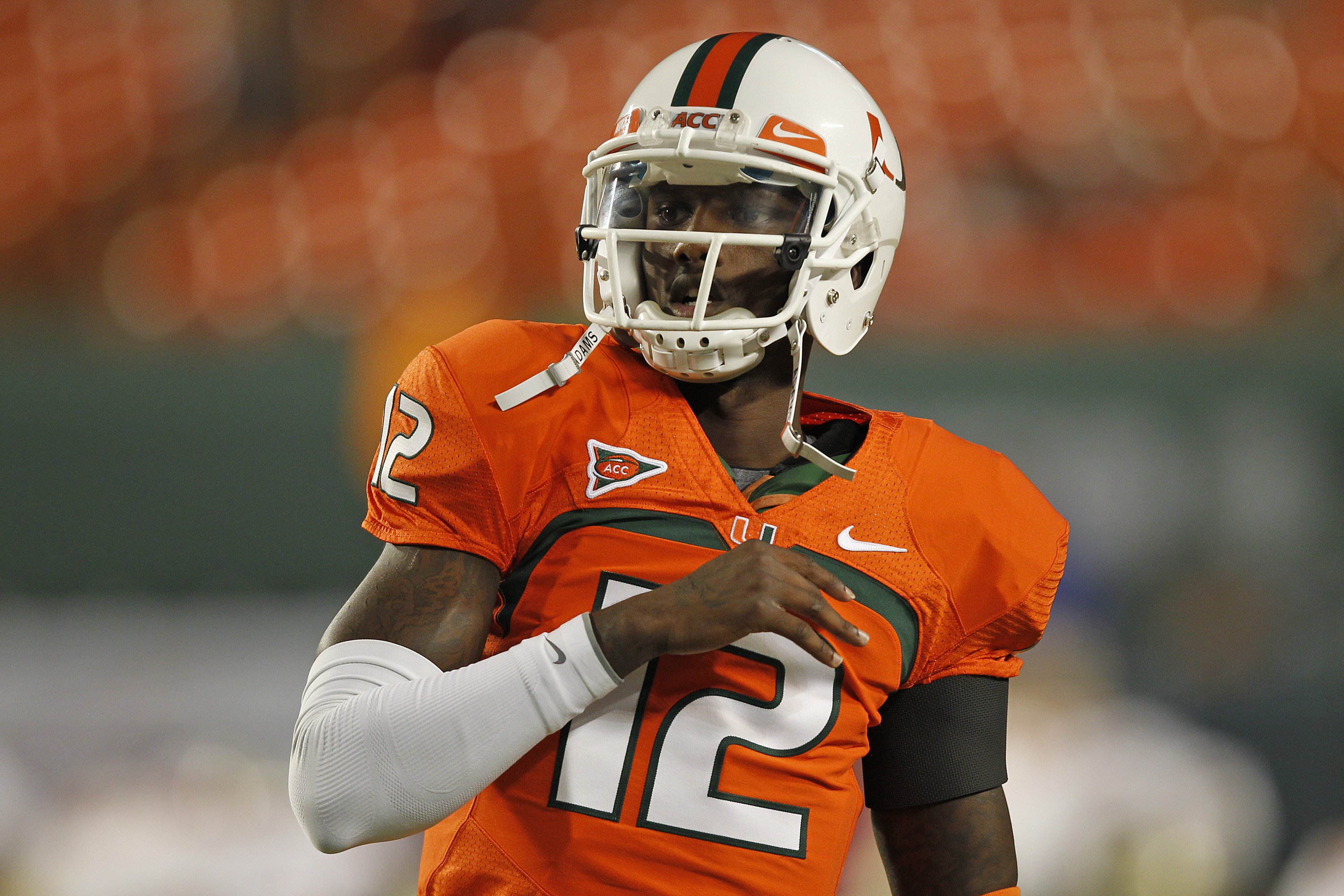 MIAMI, FL - OCTOBER 9: Jacory Harris #12 of the Miami Hurricanes warms up prior to the game against the Florida State Seminoles on October 9, 2010 at Sun Life Stadium in Miami, Florida. (Photo by Joel Auerbach/Getty Images)