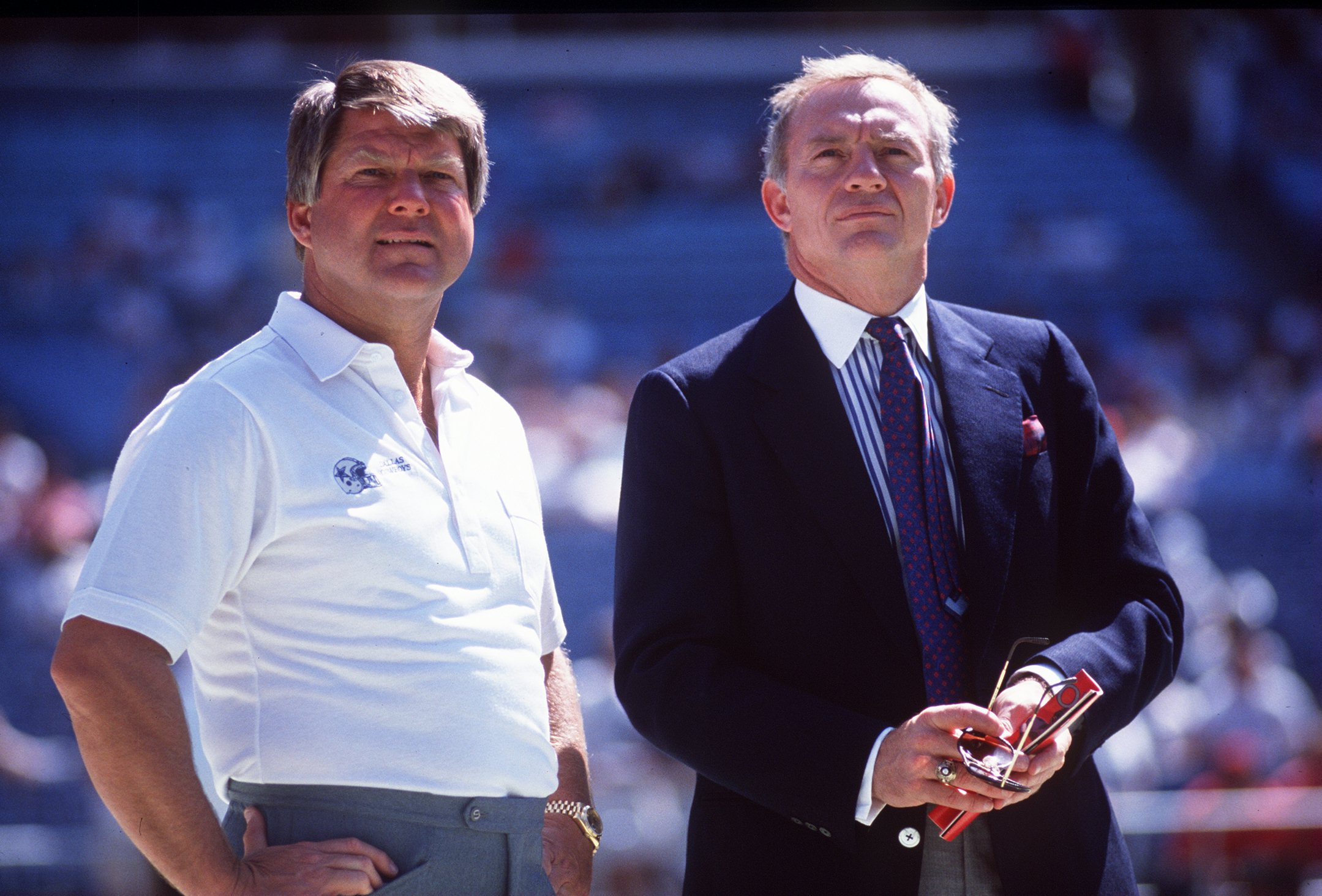 1990:  Head coach Jimmy Johnson (left) and owner Jerry Jones of the Dallas Cowboys stand together prior to the start of a Cowboys game at Texas Stadium in Irving, Texas.  Mandatory Credit: Allen Dean Steele/Allsport