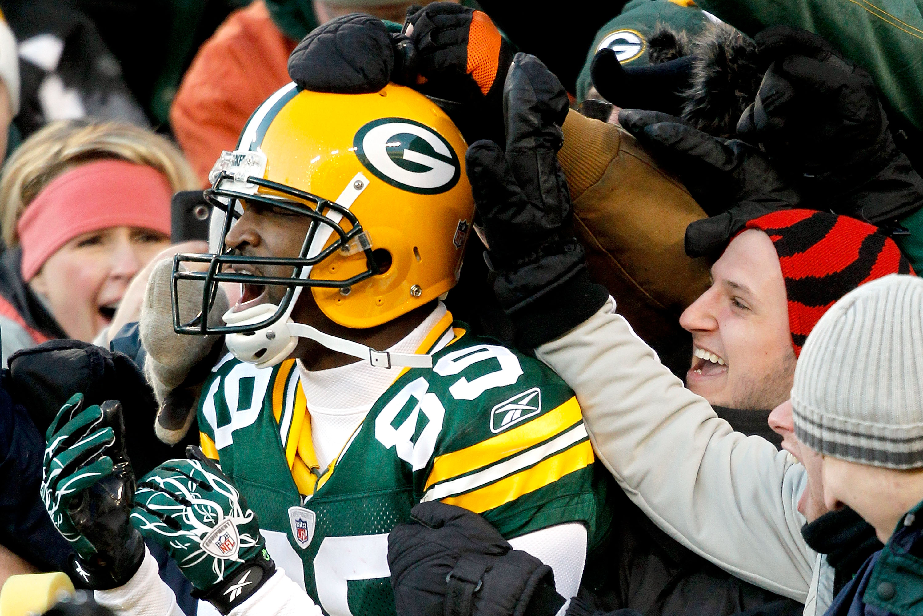 GREEN BAY, WI - DECEMBER 26:  James Jones #89 of the Green Bay Packers leaps into the stands after scoring a touchdown against the New York Giants at Lambeau Field on December 26, 2010 in Green Bay, Wisconsin.  (Photo by Matthew Stockman/Getty Images)