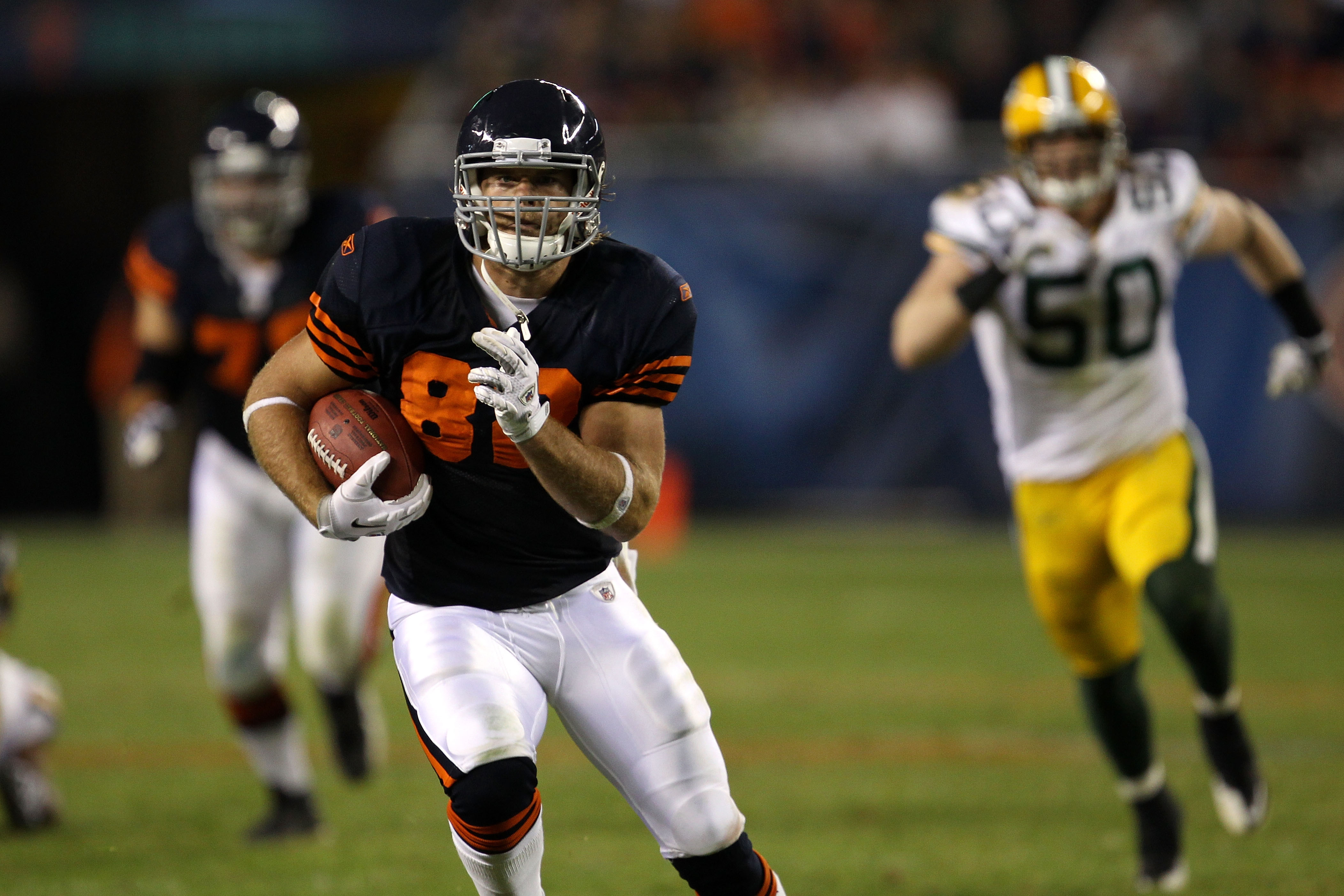 CHICAGO - SEPTEMBER 27:  Greg Olsen #82 of the Chicago Bears runs for yards after the catch against A.J. Hawk #50 of the Green Bay Packers at Soldier Field on September 27, 2010 in Chicago, Illinois. The Bears won 20-17.  (Photo by Jonathan Daniel/Getty I