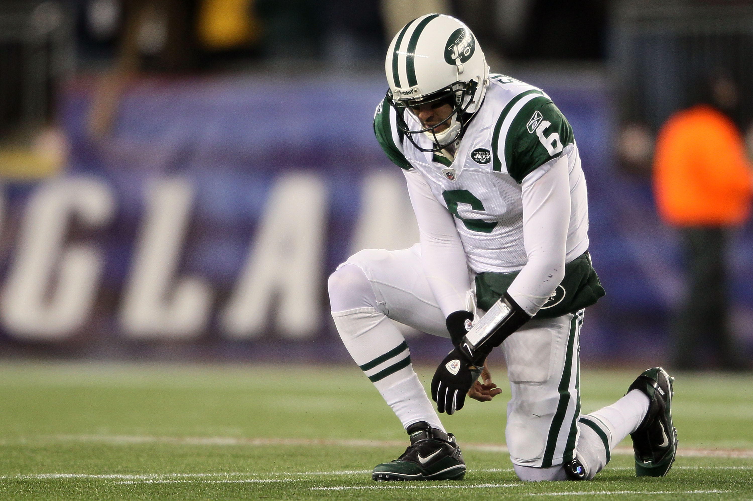 FOXBORO, MA - DECEMBER 06:  Mark Sanchez #6 of the New York Jets is slow to get up after he was knocked down on a play in the first quarter against the New England Patriots at Gillette Stadium on December 6, 2010 in Foxboro, Massachusetts.  (Photo by Elsa