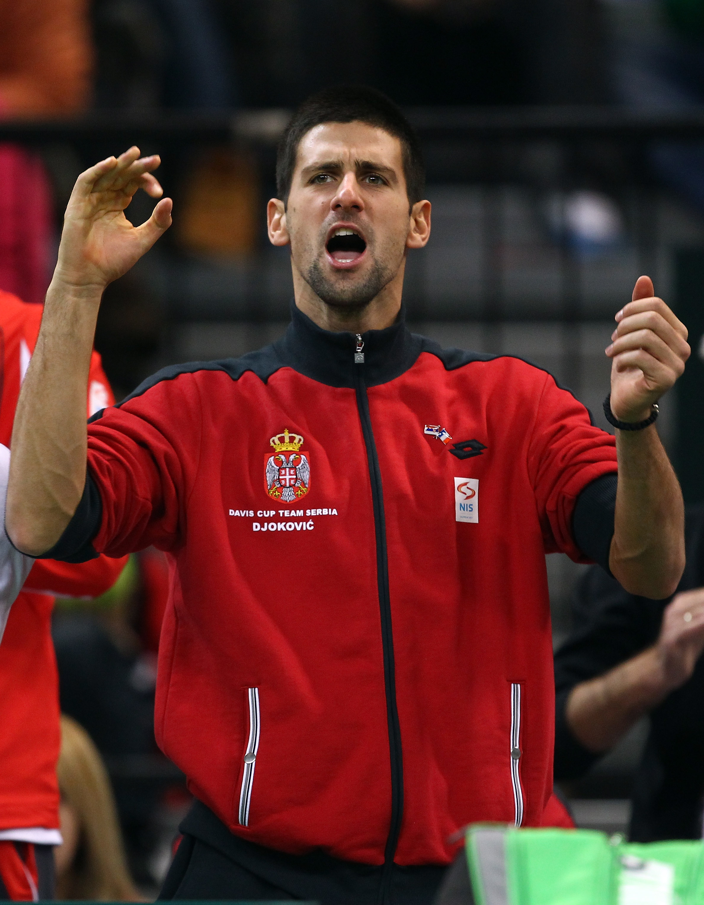 BELGRADE, SERBIA - DECEMBER 05:  Novak Djokovic of Serbia gives his support as Viktor Troicki of Serbia plays against Michael Llodra of France during day three of the Davis Cup Tennis Final at the Begrade Arena on December 5, 2010 in Belgrade, Serbia.  (P