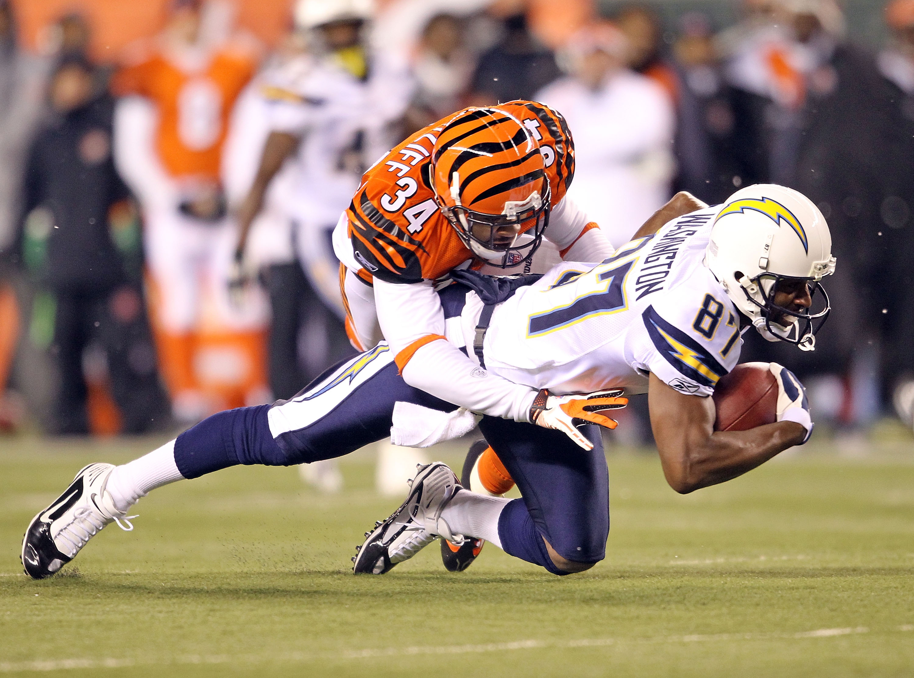 CINCINNATI - DECEMBER 26: Kelley Washington #87  of the San Diego Chargers runs with the ball while defended by Keiwan Ratliff #34 of the Cincinnati Bengals in the NFL game at Paul Brown Stadium on December 26, 2010 in Cincinnati, Ohio.  The Bengals won 3