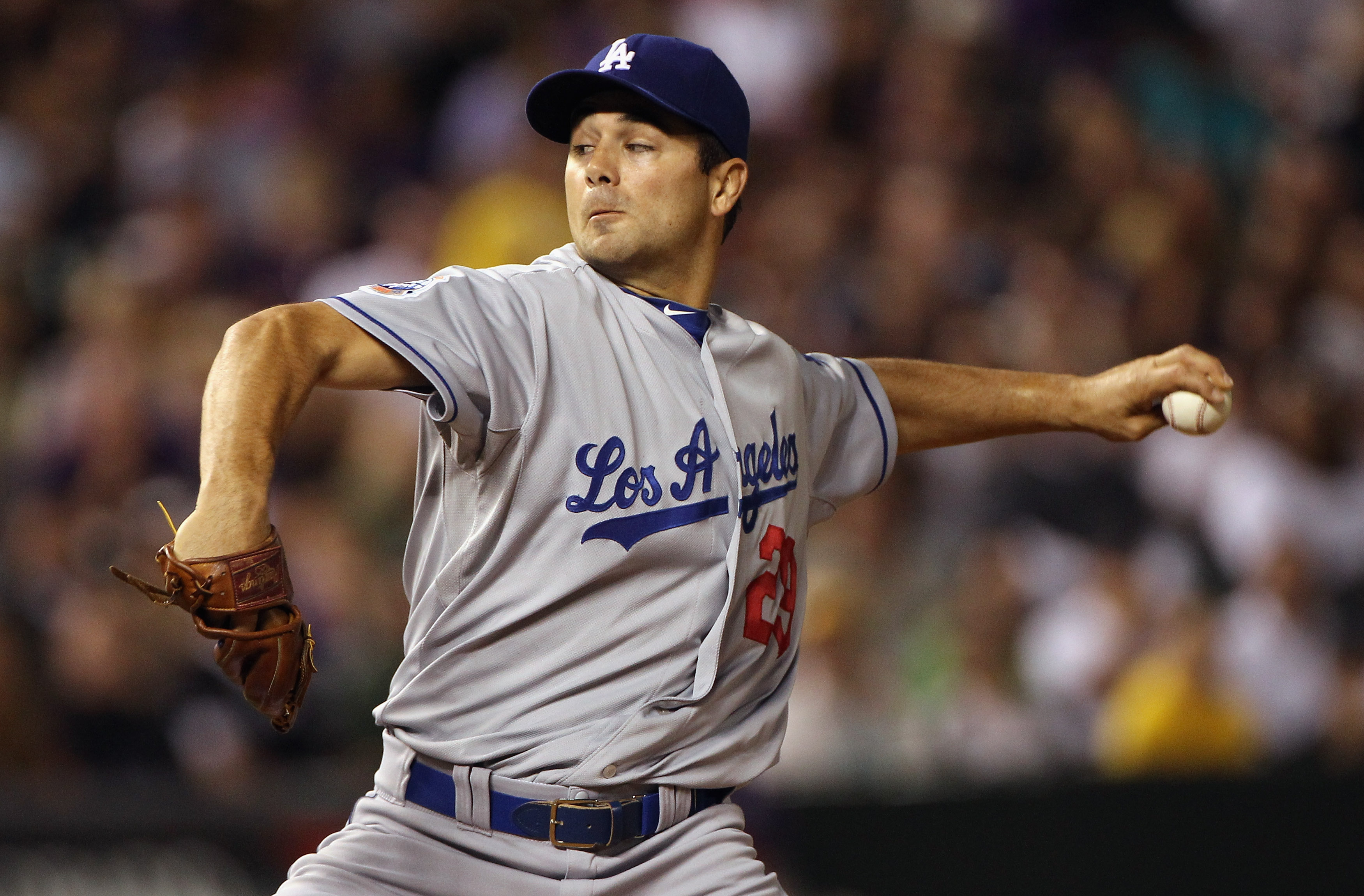 DENVER - SEPTEMBER 27:  Starting pitcher Ted Lilly #29 of the Los Angeles Dodgers delivers against the Colorado Rockies at Coors Field on September 25, 2010 in Denver, Colorado.  (Photo by Doug Pensinger/Getty Images)