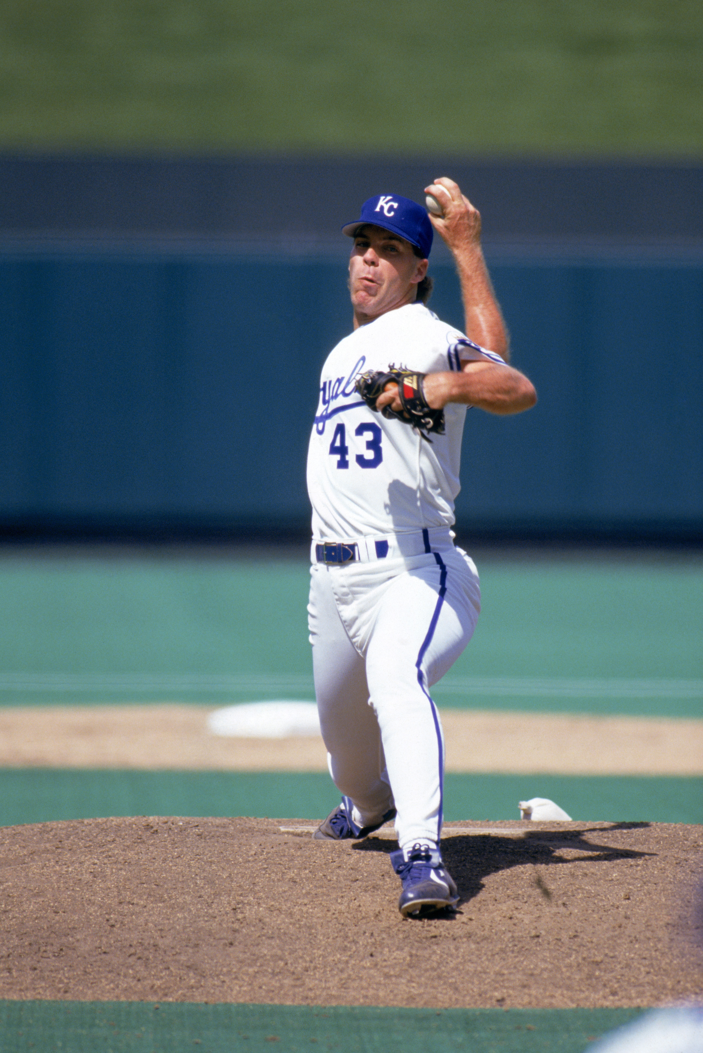 KANSAS CITY, MO - 1991:  Storm Davis #43 of the Kansas City Royals delivers a pitch during a game in July of 1991 at Royals Stadium in Kansas City, Missouri.  (Photo by Jonathan Daniel/Getty Images)