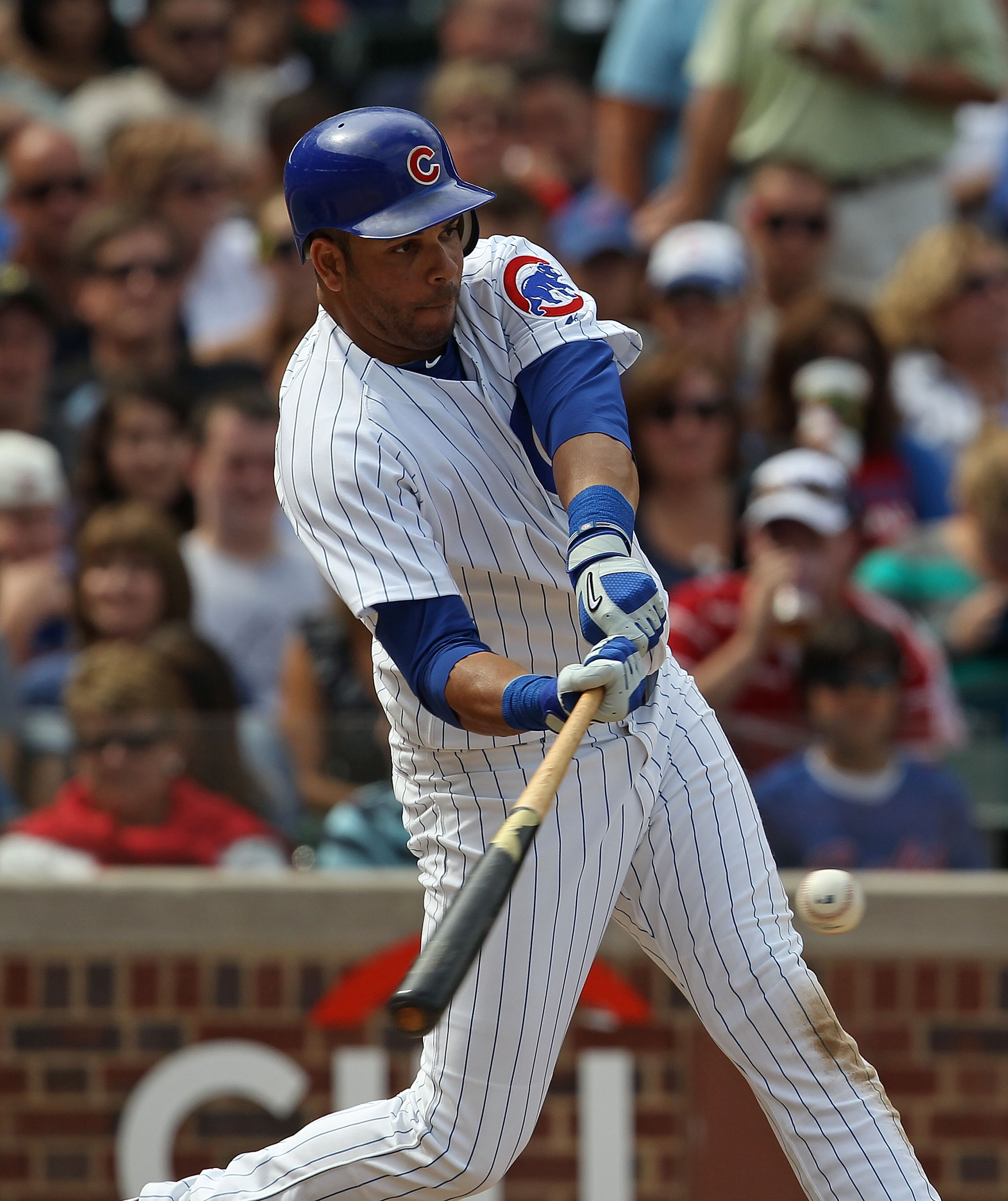 CHICAGO - SEPTEMBER 05: Aramis Ramirez #16 of the Chicago Cubs hits his 22nd home run of the year, a two run shot in the 3rd inning, against the New York Mets at Wrigley Field on September 5, 2010 in Chicago, Illinois. (Photo by Jonathan Daniel/Getty Imag