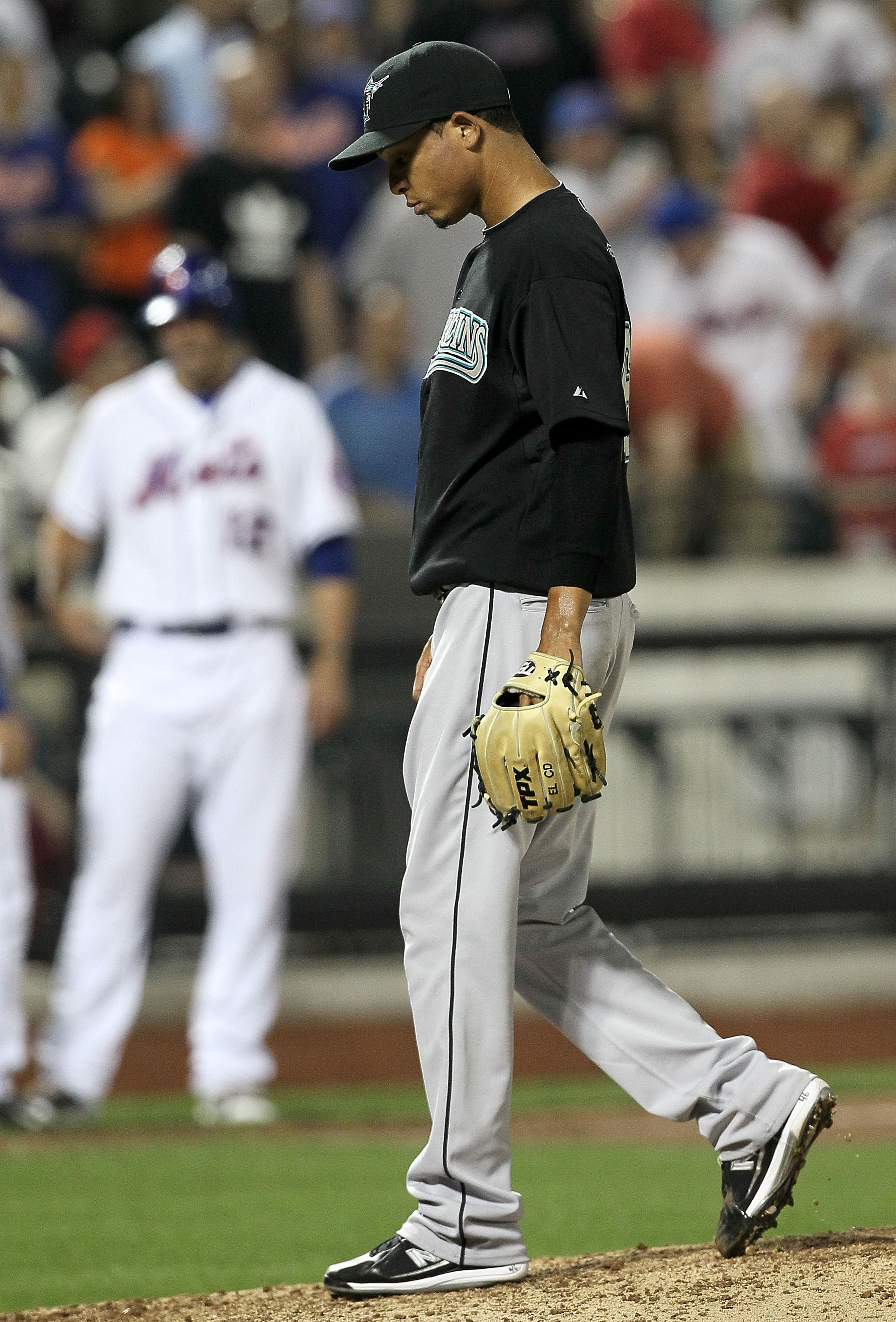 NEW YORK - APRIL 07:  Leo Nunez #46 of the Florida Marlins reacts after his eigth inning game tying bases loaded balk against the New York Mets on April 7, 2010 at Citi Field in the Flushing neighborhood of the Queens borough of New York City.  (Photo by
