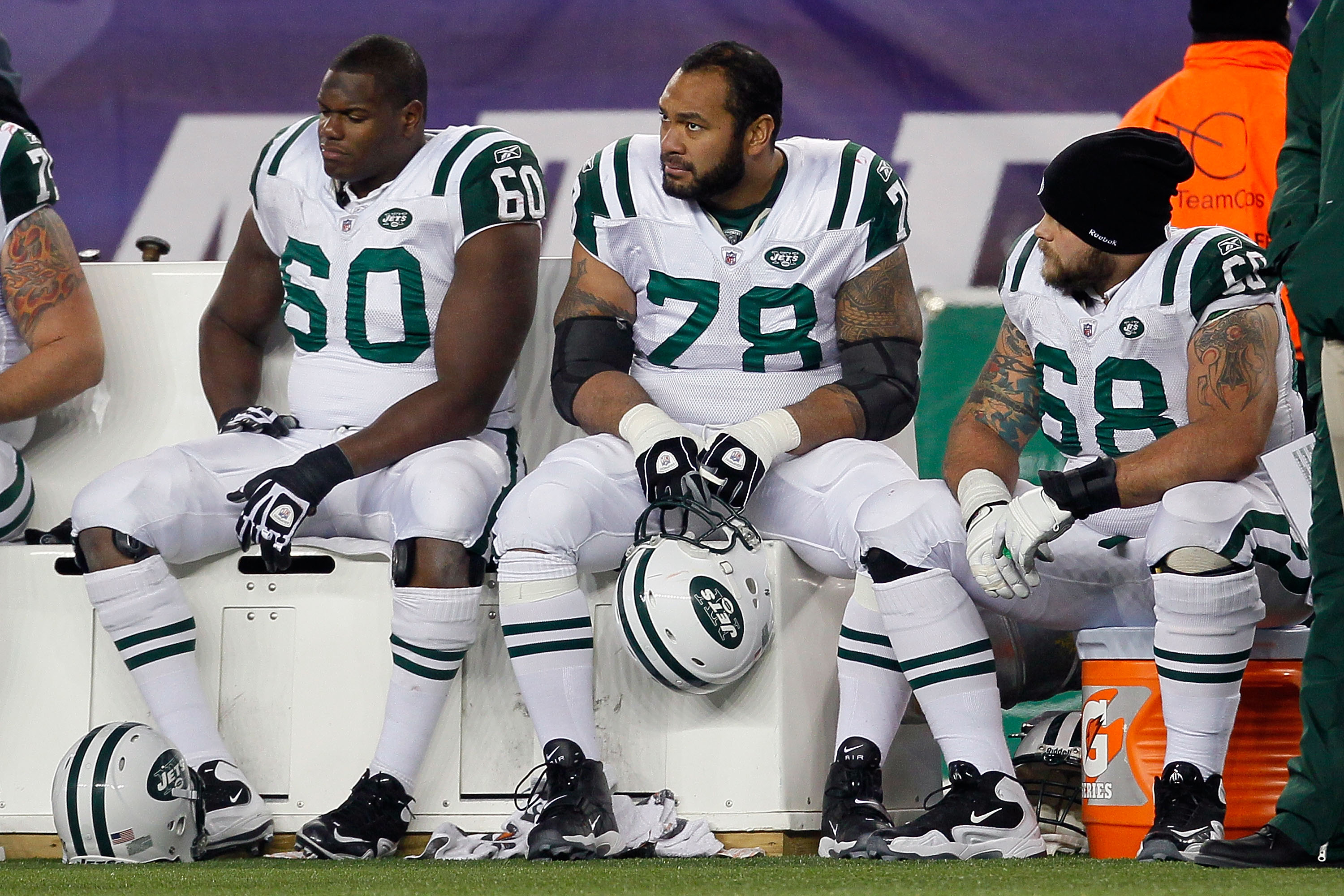 FOXBORO, MA - DECEMBER 06:  (L-R) D'Brickashaw Ferguson #60, Wayne Hunter #78 and Matt Slauson #68 of the New York Jets look on dejceted late in the fourth quarter against the New England Patriots at Gillette Stadium on December 6, 2010 in Foxboro, Massac
