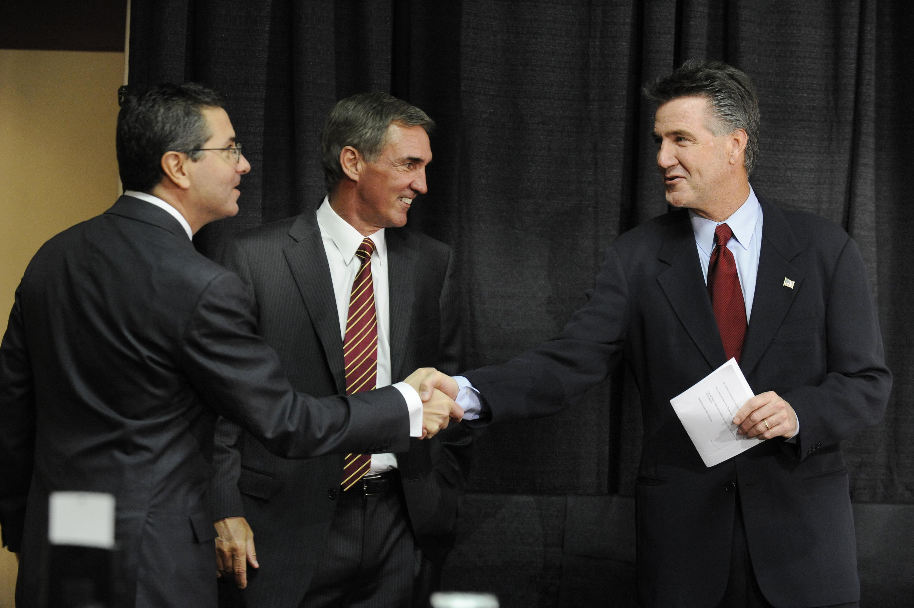 ASHBURN,VA - JANUARY 6:  Dan Snyder, owner of the Washington Redskins, Mike Shanahan the new Executive Vice President and head coach, and Bruce Allen Executive Vice President,  before a press conference welcoming Shanahan to the Redskins on January 6, 201