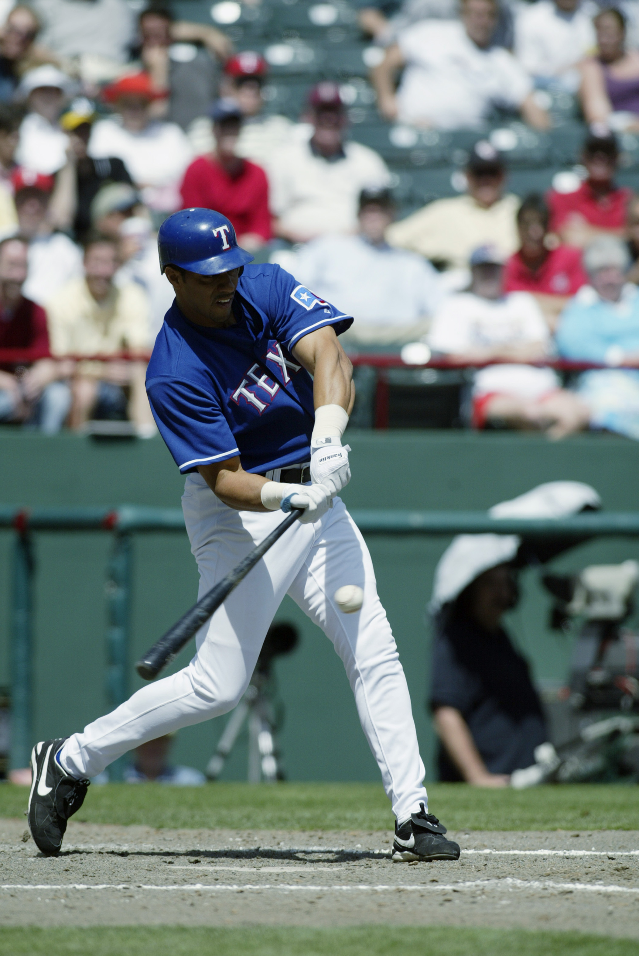 ARLINGTON, TX - APRIL 10:  Juan Gonzalez #19 of the Texas Rangers swings at a pitch during the game against the Oakland Athletics at the Ballpark in Arlington on April 10, 2003 in Arlington, Texas.  The Rangers defeated the A's 5-4.  (Photo by Ronald Mart
