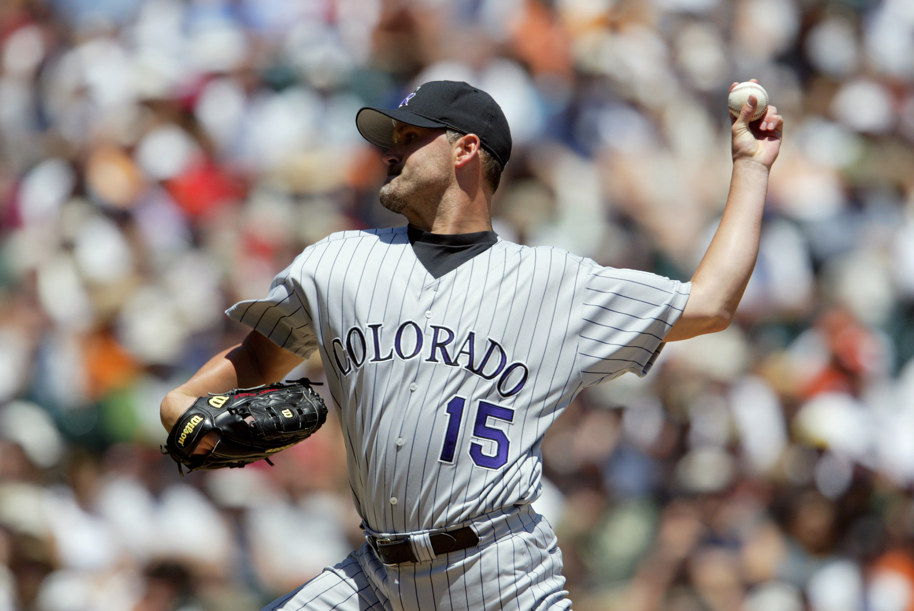 SAN FRANCISCO - JULY 20:  Starting pitcher Denny Neagle #15 of the Colorado Rockies delivers a pitch during the National League game against the San Francisco Giants at Pacific Bell Park on July 20, 2003 in San Francisco, California.  The Giants defeated